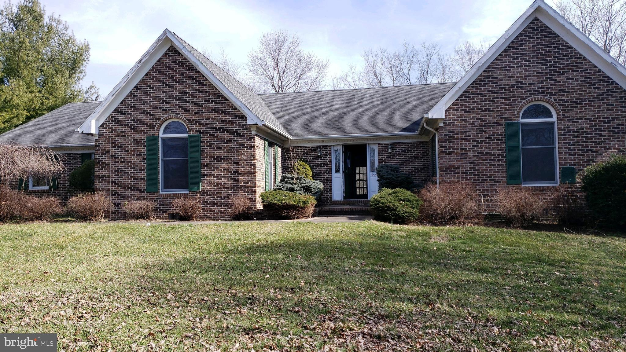 Brick Rancher featuring full basement large rec room with bar,   separate dining and living rooms, family room with fireplace.   Some hardwood floors, 4 bedrooms, 2.5 bathrooms Rear deck, 2 car garage on approx 1 acre, located in a cul-de-sac.