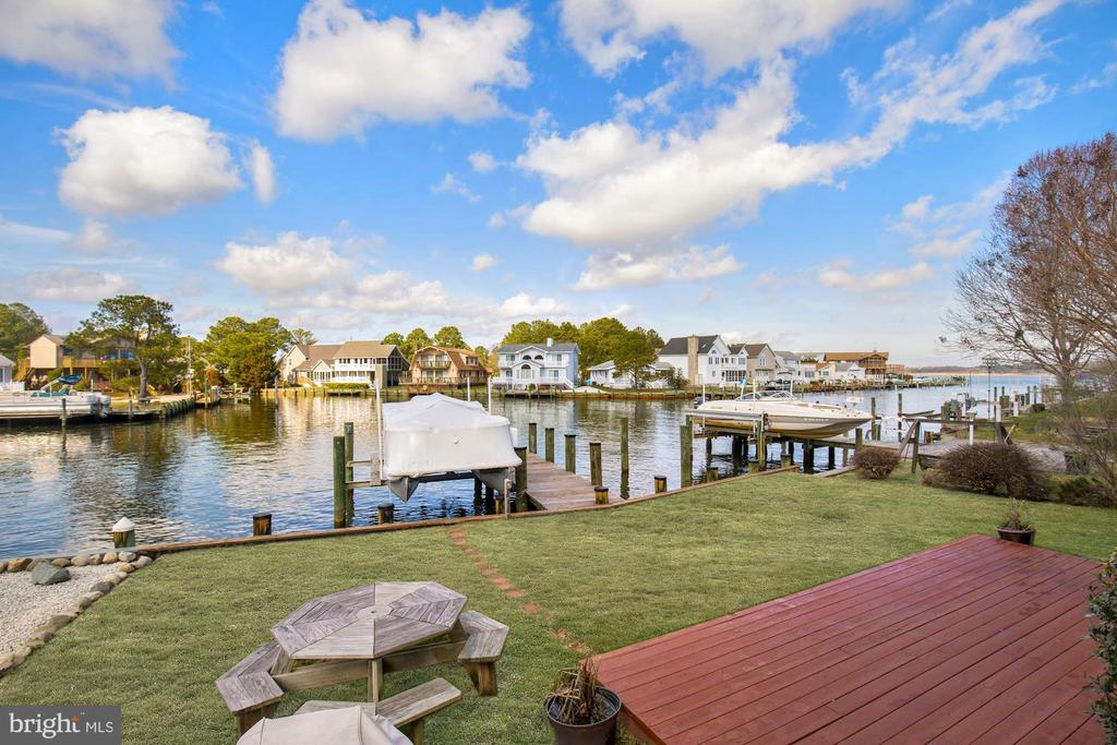 Waterfront Home -Fall in love with living on the water in this coastal home located on the canal that leads to the Saint Martin River in the desirable neighborhood of Teal Bay of the Ocean Pines Community. Grand foyer greets you will soaring high ceiling and beautiful newly installed luxury vinyl plank flooring which flows throughout. Enjoy the stunning water views from the comfort of your own living room with vaulted ceiling, gas fireplace, and deck access. Kitchen features stainless steel appliances and breakfast bar. Separate dining room is bathed in natural light. Main level master bedroom also boasts amazing water views. Upper level hosts three additional bedrooms and two full baths with overlooking loft.  Screened in porch provides the perfect place to enjoy an evening meal or cup of coffee on the water. Other exterior features include sizable deck, rear yard, pier, and boat dock and lift.  House comes fully furnished. This great location includes numerous amenities like biking/walking trails, indoor and outdoor swimming pools, racket sport, yacht and beach club with parking, farmers and artisan~s markets, boating and boat ramp, parks, fitness center and so much more! Make this home your primary residence or the perfect vacation home. The correct square footage of this home is 1985 SF