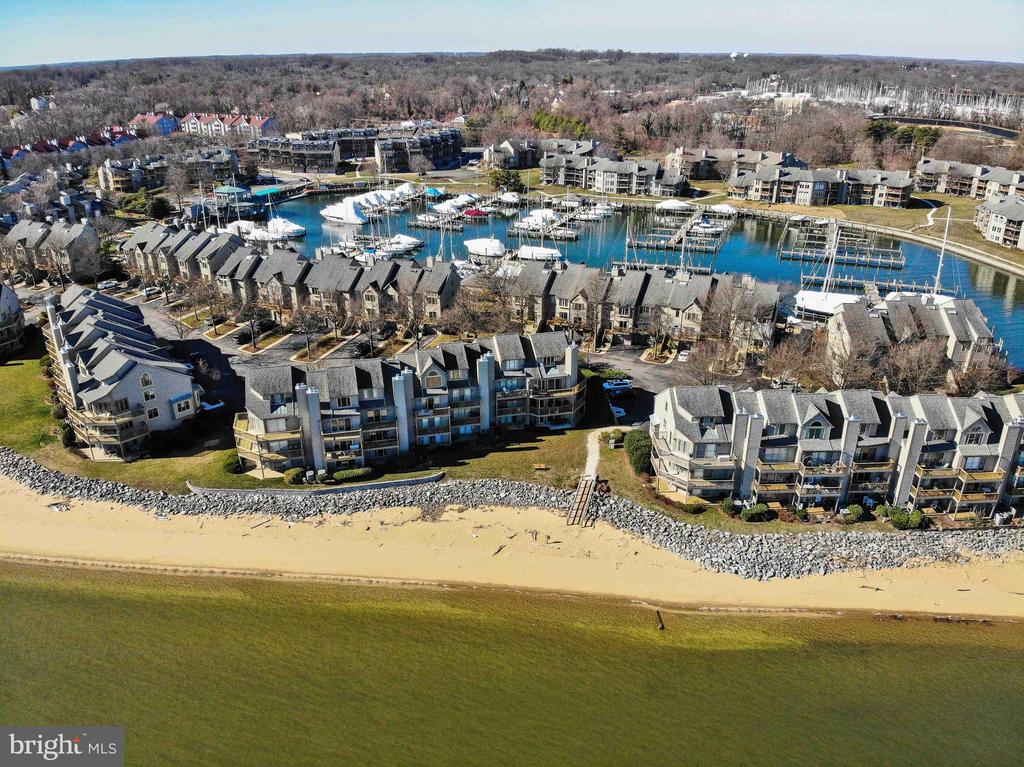 SPECTACULAR BAY FRONT END UNIT TOWN HOME WITH SWEEPING VIEWS OF THE CHESAPEAKE BAY. ONE CAR GARAGE WITH ADDITIONAL DRIVEWAY PARKING FOR 4 CARS. FROM THE MOMENT YOU STEP ONTO THE IPE DECK AT THE FRONT DOOR, YOU CAN FEEL THE QUALITY AND UPGRADES THIS HOME HAS TO OFFER AND HOW WELL IT HAS BEEN MAINTAINED. PANORAMIC VIEWS OF THE WATER FROM EVERY LEVEL OF THE HOME, EACH BEDROOM WITH AN EN SUITE BATH, THREE FIREPLACES, HARDWOOD FLOORS THROUGHOUT AND AN ELEVATOR TO ALL 4 LEVLES. VARIOUS AMENITIES INCLUDE A CEDAR LINED ROOM WHICH HOUSES 650 BOTTLE WINE REFRIGERATORS, BUILT IN SPEAKERS, PLANTATION SHUTTERS AND CUSTOM WINDOW TREATMENTS, SOLID CORE DOORS, CROWN MOLDINGS AND BUILT-IN'S. DELIBERATE FINISHES AND UPGRADES FOR EVERYDAY LIVING AND ENTERTAINING. THE CHESAPEAKE HARBOUR COMMUNITY OFFERS PRIVATE BEACH AREAS, A MARINA WITH 200+ SLIPS, OUTDOOR POOLS, TENNIS AND A RESTAURANT, ALL WITH 24/7 GATED SECURITY. FULL TIME LIVING OR LOCK AND LEAVE, THIS HOME AND COMMUNITY WILL NOT DISAPPOINT.