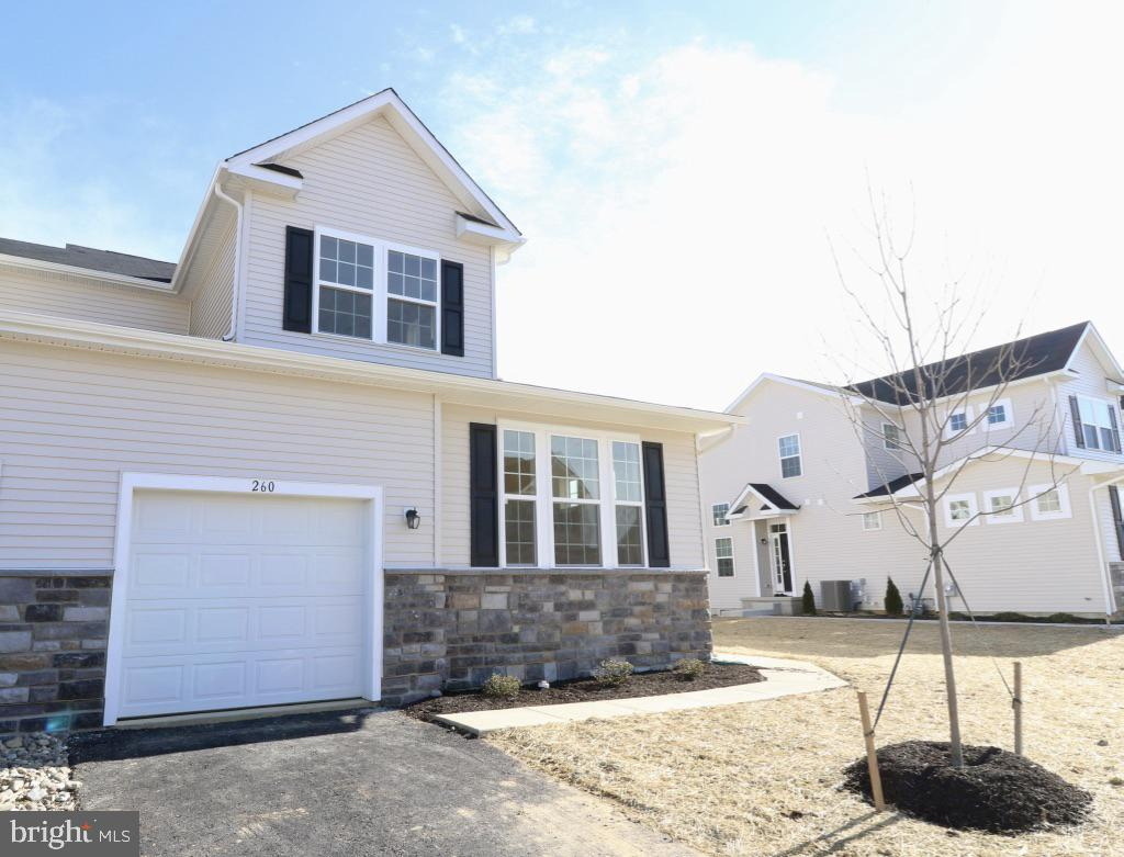 Welcome to Hyetts Crossing, the premier community right off of Route 1 to allow for an easy commute to your day to day job! This is the last NEW construction carriage home available in the neighborhood. It has a total of four bedrooms with a first floor master and two and a half bathrooms. Right when you step through the front door of your new home you are greeted with a stunning open concept floor plan with a vaulted ceiling in the great room, a gas fireplace, and hardwood floors. The kitchen features white cabinets, granite countertops, and stainless appliances (refrigerator included). In this home you will find recessed lighting throughout the first floor, hardwood stairs, and elegant craftsman rails. The second floor features three bedrooms and a spacious loft overlooking the great room. The basement is fully finished with recessed lights, carpet, and a rough in for a half bathroom. An amazing view in your backyard gives you the privacy you always wanted to have get togethers with your family and friends. Come visit us today!