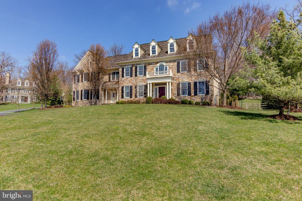 Unbelievable opportunity to own this Oustanding Colonial Manor on Premier Cul-de-sac lot in sought after community of Saybrook! This exceptional 12-year young Custom Hampton Classic Model is the largest floorplan in the community and offers over 10,000 square feet of exceptional living space! This home features quality workmanship, meticulous attention to detail, beautiful on-site finished hardwood floors, exquisite moldings, millwork and every conceivable amenity. Exterior features include a beautiful front stone facade, cedar shake roof with dormer roof lines, beautiful plantings, custom landscaping with beautiful paver walkway and fenced yard and play area. Impressive two story center hall with dramatic staircase and exquisite transverse hallway with elegant moldings and builtin cabinetry welcomes you into this lovely home. Large formal dining room adjoins large bar/Butlers pantry with elegant cherry cabinetry. A totally custom study with exquisite wainsoting, moldings and built-in cabinetry. An over-sized elegant living room with beautiful marble fireplace, state-of-the-art Kountry Kraft kitchen featuring large granite island and large breakfast room. Charming fireside family room with stone fireplace. Breakfast room and living room lead to a magnificent outside paradise designed by McIntyre Capron (a few years after the house was built) featuring a covered roof with skylights and dormer ceiling to let in light and a fantastic outside kitchen and granite bar area with built-in gas barbecue, beverage cooler, refrigerator drawers, custom lighting, a sound system and a stone wood burning fireplace with gas hook up for a fire pit. A bright and airy Sun Room with plantation shutters and two private powder rooms complete the main level. From the center hall go down to an unbelievable finished daylight lower level with large family area with an abundance of windows, exceptional custom bar, a spectacular wine cellar with large tasting area, entertainment area, exercise 