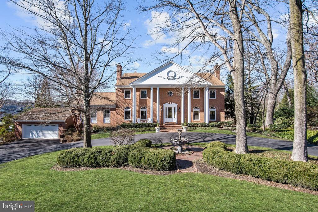 With enduring quality, this exquisite waterfront home was custom built with timeless vision and artistry worthy of the privileged position it occupies overlooking Maryland~s designated Scenic River and Asquith Bay.Outside, a thoughtful design welcomes friends and family with a circular drive and center fountain wrapped in manicured boxwood and a brick paver walk.  The main entrance is celebrated with a dramatic two- story portico and porch flanked by soaring coupled columns.  Leaded glass panels in the double eight-foot high entry doors open to a grand foyer and circular stair that together provoke a strong sense of arrival. Inside, a magical waterfront lifestyle begins here at 1128 Asquith Drive as the waterside views take center stage whilst light from picture windows, skylights, multiple atrium doors and generous sidelights bathe each room with sunlight. On the main level, windows and glass panel doors bring the Severn River immediately into view from the Dining Room, Family Room, Kitchen and main level Master Suite. On the waterside, an expansive wrap-around TREX deck offers low maintenance outdoor living and entertaining. Outdoor entertaining venues are endless with upper and lower covered decks, built-in grille and wood burning fire feature. Decks are linked by two cascading staircases that seem to gesture to the water~s edge, featuring a nearly new sea wall, two private piers, mooring, lift, and dock that will accommodate a 50~ vessel in 8-foot deep water. Gather well and gather often after a day of boating to enjoy casual meals or Maryland crabs in the screened-in crab shack/pavilion.Casual living and entertaining continues inside in the lower level bathed in full daylight, and outfitted with an expansive wet bar, billiards area, wine cellar and theater. More than ample storage and multiple flex rooms provide a variety of lifestyle options, as well as a generously sized attached garage and workshop. There is simply no match to the combination of amenities, d