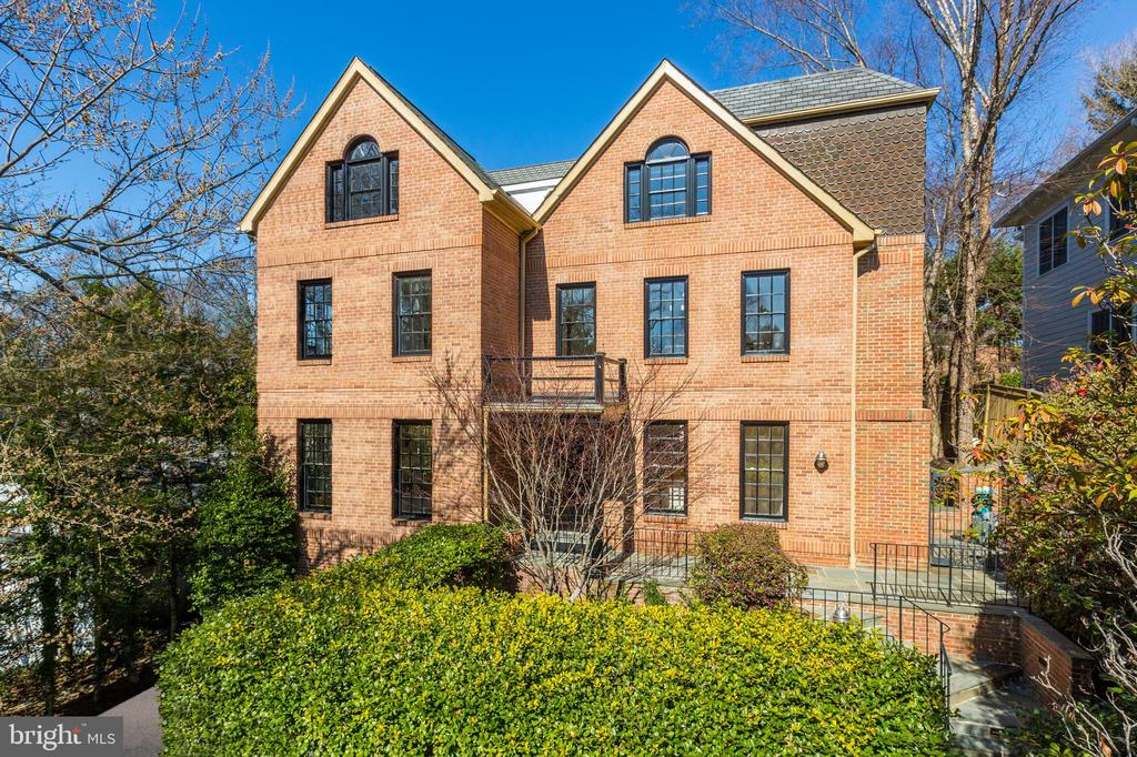 **Nervous buyer released, your chance to claim historic value** Located in prestigious, Kent. 5019 is a stunning red-brick colonial with black muntin windows, veiled behind mature plantings and situated on the trophy stretch of Klingle Street - offering 6500 square feet of privacy and grandeur.  Fine glazed millwork and architectural detailing at every turn. Elegance is evident from every angle.  Every modern treatment and amenity, including maple hardwood flooring and intricate hand-tooled wrought iron banisters, several gas fireplaces and an elevator which serves all four levels. A dumbwaiter for effortless entertaining, garage parking and five generous bedrooms and five and a half baths.  A heated swimming pool and massive outdoor terrace completes the picture at Kent's very best value proposition. For more information including a video, view the virtual tour at 5019klingle.com