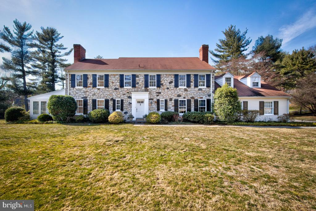 Welcome to this Sherman Reed classic stone colonial with superb curb appeal.  Located at the corner of a quiet lane, this spacious 5 bedroom, 4 1/2 bath home resides in the highly desirable neighborhood of Villanova. Secluded and serene, this lovely home is surrounded by greenery and seasonal landscaping and backs up to Appleford, a 22-acre arboretum and bird sanctuary. This well cared for property offers the opportunity to live in the renowned Lower Merion School District and awaits a new generation to make it their own.The home exudes classic quality with original oak hardwood floors, numerous picture windows with deep windowsills, spacious rooms for easy living spaces and flow for today~s lifestyle. The front to back living room with marble fireplace surround and an oversized formal dining room provide wonderful spaces to gather with family and friends.  An eat-in kitchen, a wood-paneled study with bookshelves and a fireplace, a half bath, a walk-in hall closet, and a beautiful stairway make the grand foyer a welcoming entrance.  The south-facing sunroom, accessed from the living room, overlooks the private yard.  A two-car attached garage, mudroom and back staircase complete the first floor. Upstairs a spacious master suite with a large walk-in closet and two master bathrooms provides ample space to relax.  There are 3 additional generous bedrooms, a hall bath, two linen closets, and a 5th bedroom with a private full bath.  This 5th bedroom has use of backstairs and could be ideal for a nanny, in-laws, or a home office.A full set of stairs lead to the expansive unfinished attic with a cedar closet and has the potential to be finished for more living space.  The partially finished lower level is perfect for a renovation with outside access to the landscaped pool area.  The 2013 septic system and 2019 electrical panel upgrades have been done.  The new owners can begin renovating the cosmetic details to make it their family dream home.  Conveniently located just mi