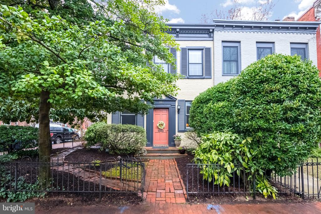 Located in the shadows of the US Capitol, this classic Federal-style townhome dates back to 1850.  As you walk through the home you can see the careful attention the homeowners have taken to blend modern conveniences while keeping the home's historic character and charm intact.  Features include a wide formal living and separate dining room, a rear family room with wood-burning fireplace, a modern open kitchen w/ custom built-in cabinetry,  a private side porch, renovated spa-like baths, and an enclosed four-season porch off the master suite.  The corner lot allows for additional windows giving the home a bright and airy feel. How soon you forget this home is situated minutes to three METRO stations, Eastern Market & Barracks Row.  WELCOME HOME!