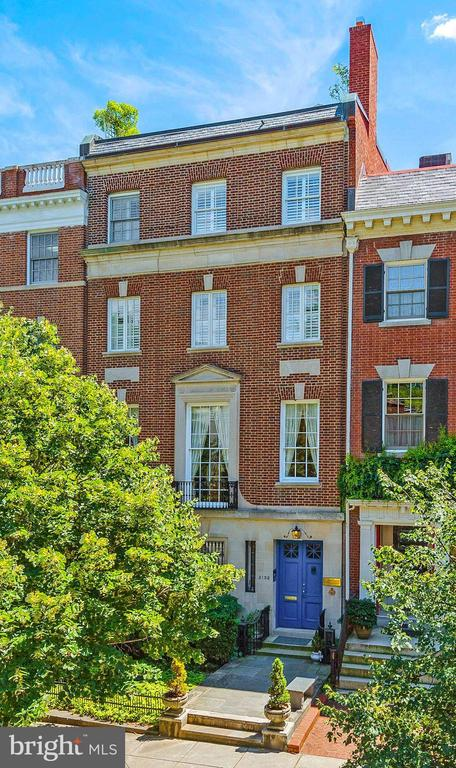 Welcome to this exceptional home in the heart of historic Kalorama, just steps from Embassy Row and Dupont Circle. This magnificent 6-level home amazes immediately and continues to astound upon entry. A grand, elegant foyer includes a palatial staircase and access to six bedrooms, as well as six offices, 7 fireplaces, elevator, plus six full and two half baths. Two of the bedrooms are part of guest suites on the third and fourth floors, each of which can be accessed from a back staircase. The suites include large sitting areas, kitchens, walk-in closets, full baths with washer/ dryer, and private balconies. The formal living room, elegant sitting room and kitchen with copper doors open to the dining room, all of which make for a lovely entertaining space. The lower level spa area features an endless pool and sauna, while the top reveals an incredible roof-top deck with a hot tub. Unusual for this area, there are 2 garage and 3 driveway parking spots. With ample space and amenities, plus a diplomatic overlay, the property  has endless possibilities, and plenty of room for working and school from home!