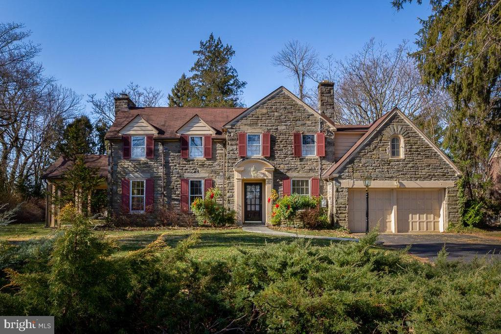 This masterfully crafted stone colonial located on a most desirable Penn Valley street exudes quality, with hard to replicate details of the past including deep window sills, intricate crown molding, gorgeous archways, and hardwood floors. Must-haves for today's living are the upgraded kitchen and baths, and an expanded, renovated master suite. Another exceptional feature of this property is the 1953 family room addition designed by renowned local architect Vincent Kling. Enter the entry foyer from the arched-portico covered front door, and take in all the details that make this home so special. The foyer connects on the left to the expansive living room with wood-burning fireplace and bay window exiting to the covered flagstone porch, or on the right to a bright, cheery office with built-in white cabinetry, file drawers and shelves. Through the foyer arches, the hallway gives a glimpse of the back of the property while offering a good-sized closet, Italian Murano glass sconces, and a lovely powder room. Enter the large dining room with deep-silled windows plus a beautifully milled archway to a bonus alcove that exits to a bluestone patio. The dining room also accesses the large Vincent Kling family room addition which includes big, bright windows, a copper fireplace, an exposed stone wall, extensive built-ins and an outside entrance to the back yard. Step from the dining room to the slate-floored kitchen with white cabinetry including cabinet-front refrigerator and dishwasher, stainless steel corner sink, Bosch gas stove and built-in microwave, and leather-finished granite countertops. Step down to the breakfast room with Pella sliding doors containing built-in blinds to additional stone patio with gas grill and dedicated gas line, and continue from breakfast room to pantry, attached 2-car garage, and hallway to lower level and entry foyer. Upstairs is a large master suite with bay window and 2 walk-in closets with organization systems, and a huge Carrera marble master bath featuring steam shower, jetted tub and make-up vanity. The upstairs also contains a second en suite bedroom with large closet fashioned from former back stairs, two more sizeable bedrooms with ample closet space, a marble hall bath with steam shower, a hall combination linen/cedar closet, and pull-down stairs which accesses great storage in the big, unfinished attic. The lower level offers a finished flex space w/fireplace, sauna and laundry room, as well as a mechanical room with brand new central air, central heat and hot water heater. On a half-acre level lot, this home provides easy access to Lower Merion schools, shopping, and all major highways. No sale sign on property.  One-year, 2-10 Home Warranty included with sale.  Please remove shoes or wear booties and follow all COVID-19 guidelines when viewing property. Offers will be reviewed Sunday, June 14, 2020 at 8:00 PM.