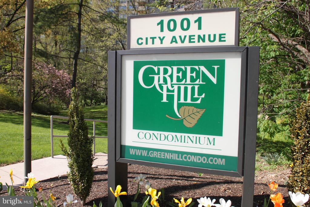 Welcome to this wonderful one-bedroom first-floor condo in Green Hill Condominiums located in Wynnewood,  Lower Merion. You will feel like a gourmet chef in this beautifully updated kitchen with granite countertop and a breakfast bar. Enjoy a meal next to the soundproof sliding glass door overlooking the pool area and tree-lined landscaping. Very large rooms with a nice flow from the kitchen into the living room. The neutral color palette and hardwood floors throughout make decorating and moving in easy and stress-free. Courtesy shuttle to close by shopping,  indoor and outdoor pools, walking paths, tennis courts, 24  security and so much more. New owners can join the fitness center or do laps in the community pool for an additional fee If you haven't been to Green Hill recently, note the newly modernized lobbies, hallways, and common areas. Utilities and insurance are included in the monthly condo fee except for the internet, cable, and phone. There is a one-time non-refundable $150 move-in fee and a $500 refundable move-in deposit if no damage. Condo fee is $598/mos. Special Assessment Fee for renovations thru 2026 of 1.25% of yearly condo fee paid in 3 installments.