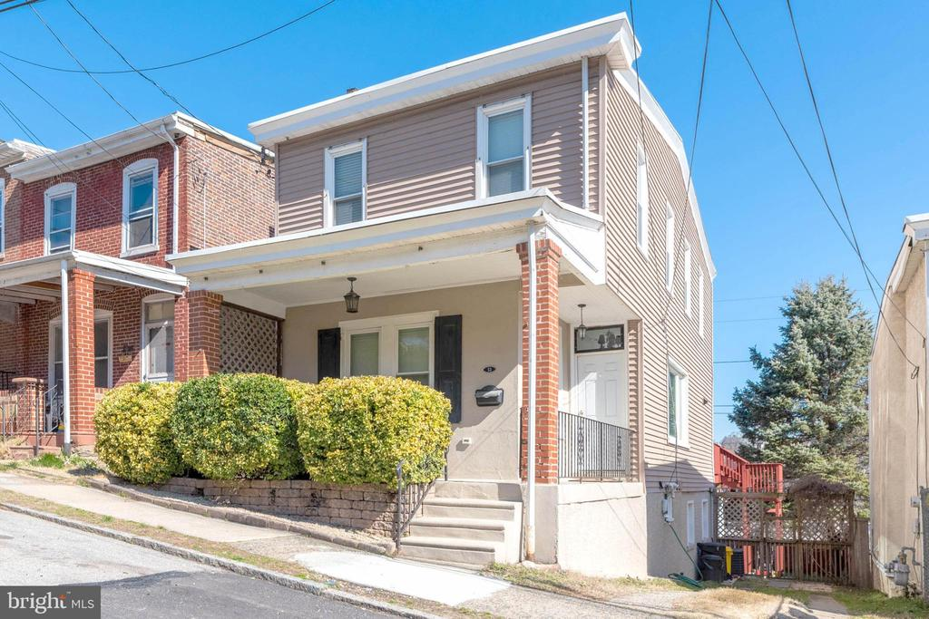 """See a link to the amazing Matterport 3d tour here: https://my.matterport.com/show/?m=tw2ZMh1mQiE  This beautiful newly renovated 3 Bed / 2 Bath single family home in the highly sought-after Belmont Hills neighborhood is located within walking distance to Manayunk and features breathtaking views of the city and Schuylkill River! Enter into a welcoming open vestibule area, which features a custom built solid wood bench seat with coat hangers and storage cubbies. The first floor is ideal for entertaining guests with an open floor plan including a spacious living room, large dining area, and a totally renovated kitchen with stainless steel appliances, a 5-burner gas range, double undermount sink, decorative modern backsplash, an island with stools featuring gorgeous granite countertops and darker-tone cabinetry that compliments the shaker-style white 42"""" glass-in-door cabinetry, and a large pantry.  Beyond the kitchen is a glass panel door that leads to the deck with views of Manayunk and the Schuylkill River - great for your morning coffee, evening cocktail, or anytime outdoor entertaining! Other features of the first floor include recessed lighting throughout and elegant crown molding.  The newer staircase with a black iron baluster railing leads to the second floor which includes 3 sun-soaked bedrooms with ceiling fans and a full bath.  The sizable master bedroom has two separate closets with plenty of space.  The completely renovated full hall bath features a vanity with a granite countertop, tile floor and tub surround.  Additional highlights of the second floor include double crown molding and a hall closet.  The daylight walk-out basement is partially finished and features stunning exposed fieldstone and brick walls with inset built-in shelving, a brand new full bath, water-resistant plank vinyl wood-style flooring, laundry area with storage, and a heated 3-season room with sliding glass doors and exposed brick - perfect for an in-home gym, office, or more! Other"""