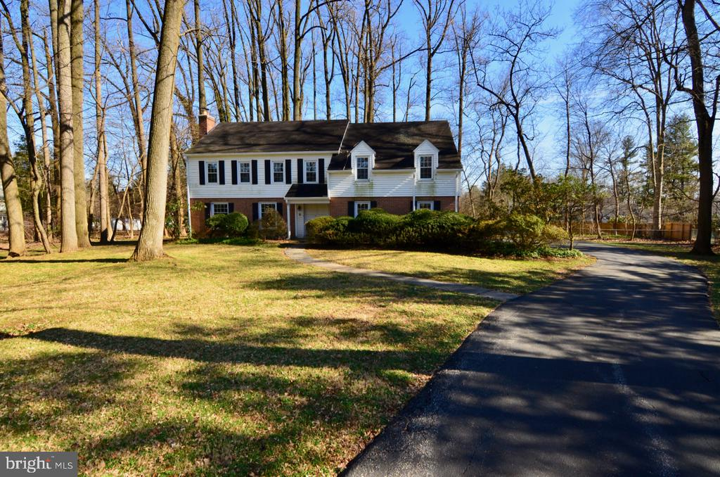 Amazing opportunity to purchase a spacious brick colonial situated on a level .88-acre lot on a quiet cul-de-sac in Radnor Township.  This home includes five bedrooms, two full and one-half bathrooms, a partially finished lower level, 2,746 sq ft of above grade living space, in-ground pool, and a two-car side entry garage.  Main level has traditional center hall entrance foyer, large living room with wood burning fireplace, dining room, eat-in kitchen, cozy den with fireplace and access to rear patio, half bathroom, and inside access to garage.  Upper level has master suite with double closets and full bathroom, four large secondary bedrooms with ample closet space, a full hall bathroom, and two linen closets in the hallway.  Other features include hardwood floors throughout most of first and second level, newer vinyl replacement windows throughout, and newer garage doors and openers.  The lower level is unfinished with full height foundation walls under foyer, kitchen, living room, and dining room, crawl space under the den, and a perimeter French drain tied to a sump pump.   The property is conveniently located to all major commuter routes, downtown Wayne, shopping, dining, and is part of the highly rated Radnor School District.