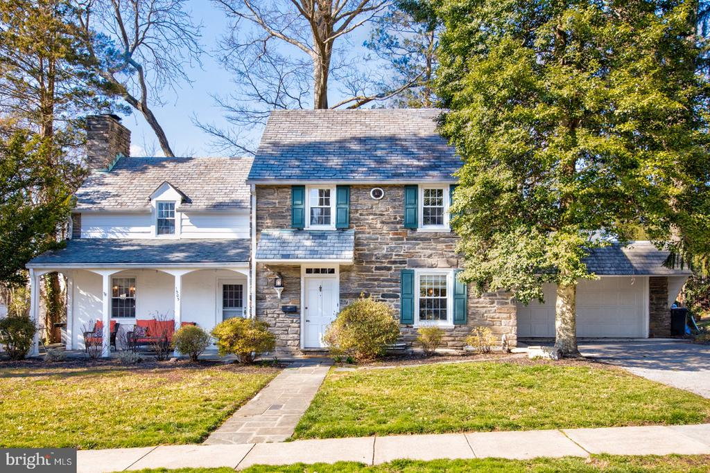 Welcome to 1505 Surrey Lane.  This classic Overbrook Hills stone colonial offers 2,006 square feet of above grade living space, four bedrooms, two full and one-half bathrooms, a finished basement, two-car front entry garage and incredible curb appeal.  First floor features welcoming center hall foyer with coat closet, powder room, and turned staircase with oak treads, gorgeous living room with wood burning fireplace and exit doors to front porch and side flagstone patio, and a spacious dining room.  The recently renovated kitchen has handsome white cabinetry, quartz countertop, marble subway backsplash, stainless steel appliances, farm sink, and breakfast bar overhang with butcher-block countertop.  The master bedroom suite has ample closet space and a full bathroom with tile floors, tile surround, and pedestal sink.  Two comfortable secondary bedrooms, a full hall bathroom, and a linen closet complete the second level.  The recently finished lower level has a large recreation room, fourth bedroom, and unfinished space for storage.  Other features and improvements include gorgeous hardwood floors throughout first and second floor, neutral paint, new garage roof, annual maintenance of slate roof, and new chimney liner.  This home is walking distance to Penn Wynne Elementary School, Penn Wynne Library, restaurants, shopping, Septa Regional and 100 Rail Lines, Wynnewood Valley & Powder Mill Parks, 20 minutes from center city Philadelphia, and is part of the top rated Lower Merion School District.