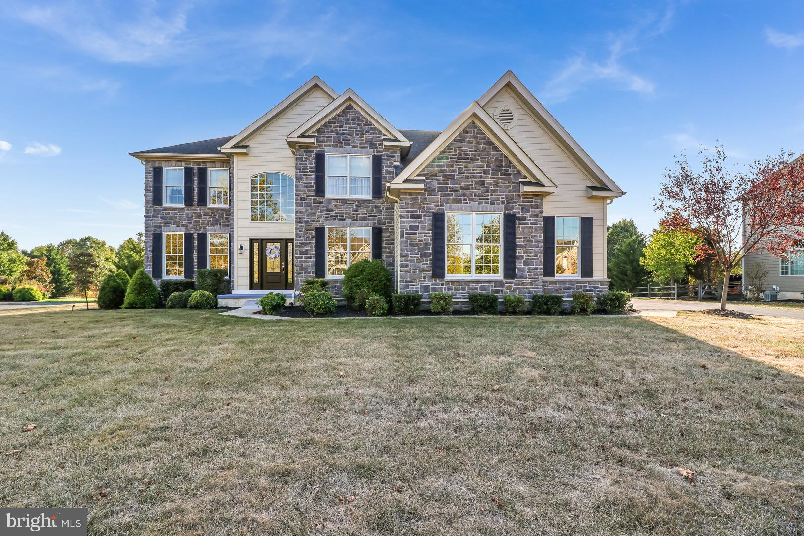 Stunning 4BR/4.1BA Elkins model with brand-new siding and 3-car turned garage available in popular Red Lion Chase! Walk into the elegant 2-story foyer with turned staircase and note the rich hardwood flooring that leads to the oversized eat-in kitchen with walk-in pantry, huge center island, and gorgeous cherry cabinets. The open floor plan lends itself to entertaining with its massive living/dining room combination; spectacular sunken two-story family room with a magnificent wall of windows and stone fireplace; and giant solarium that leads to a large composite deck that overlooks a .56-acre flat lot that backs to open space. Take the back staircase up to the 2nd floor and check out the enormous master bedroom with sitting area, huge master bath with garden tub and his & hers sinks, and a walk-in closet that would make Oprah's knees weak! Head down the hall for the 2nd and 3rd bedrooms joined by a large Jack & Jill bathroom and the 4th bedroom with its own private bath. The finished basement features a gorgeous granite bar with tile backsplash, exercise room, and full bath, plus extra storage for all of your treasures!