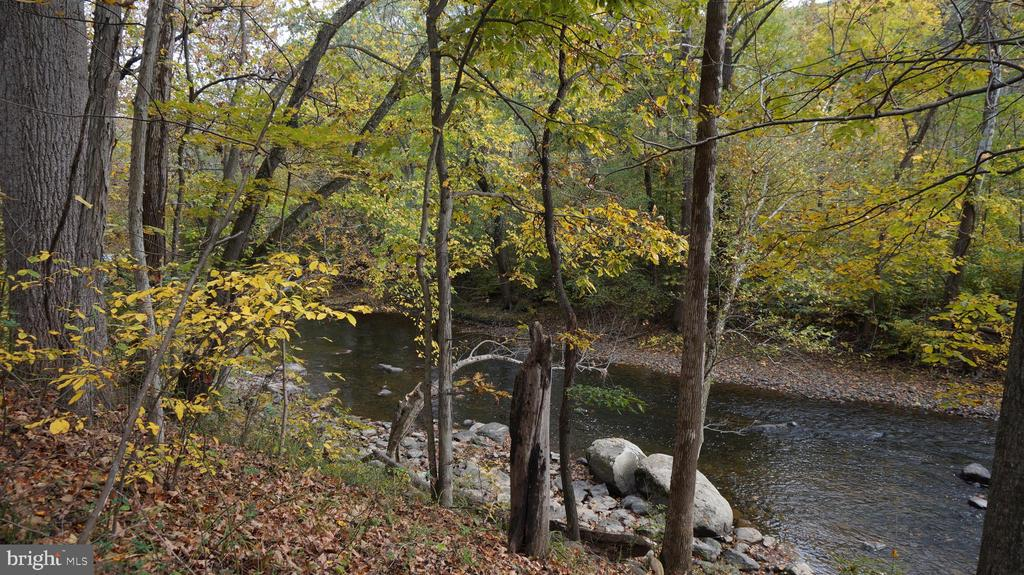 Beautiful River Front Lot with 3 bedroom septic already installed.   Explore the possibilities of building your cabin here.   Enjoy resting on the river bank,  fishing, swimming or floating down the river.   .92 acre - protective covenants and restrictions.