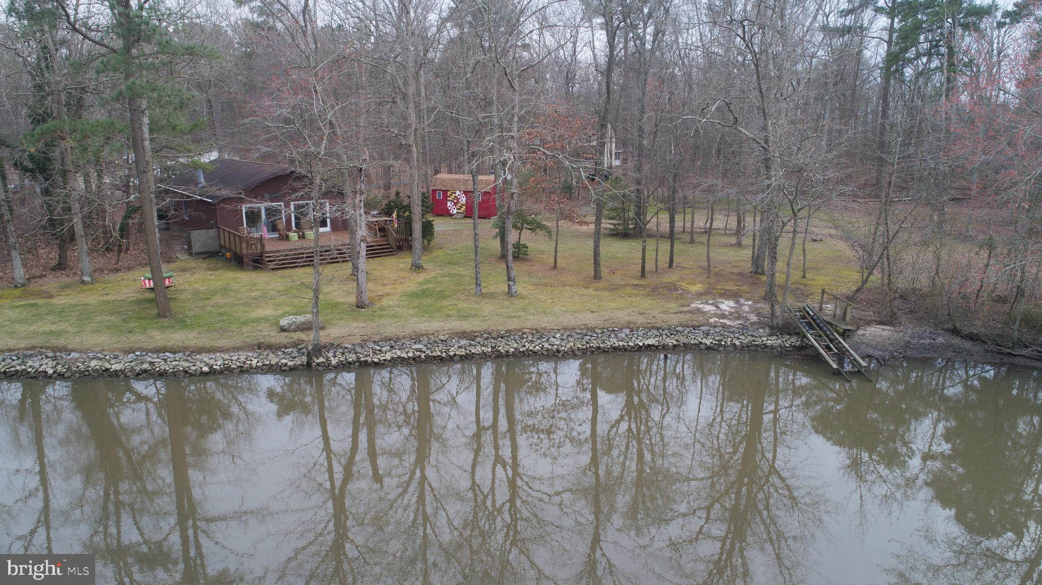 Nestled among mature  trees,  you'll  enjoy beautiful water views over the Choptank  from this 3 BR home.  Centrally located ,  this property offers quick access to Easton and all Mid Shore locations.   Wood floors throughout , deck, pellet stove, and a granite kitchen are a few of the upgrades. Protected shoreline.  Launching ramp for jet skis, kayaks, SUP, canoes.  Outdoor shower.  A great place to  star gaze and listen to the frogs!