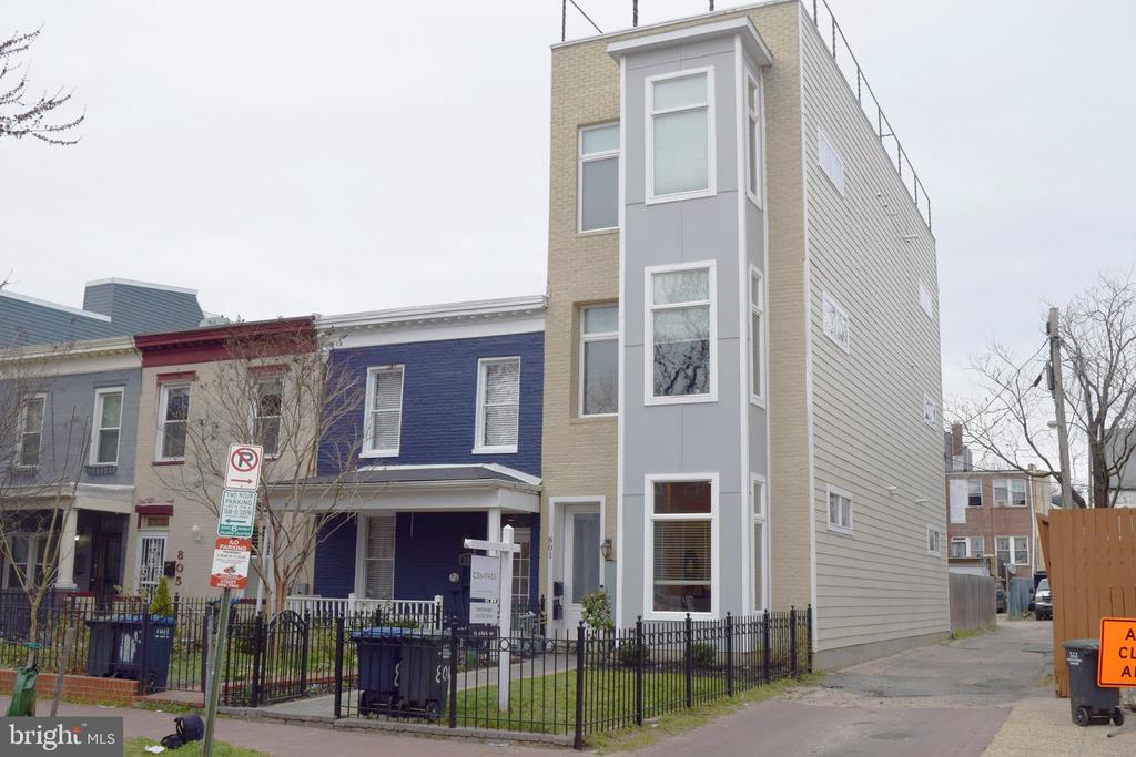 Stunning 2-level condo in the heart of the H Street Corridor at 9th and H, NE. Simply walk out of your door and within a quarter block, everything is at your fingertips: restaurants, nightlife, grocery and other shopping, and transportation. This is a commuter~s dream. What more could you want? How about a remarkable open living/dining/kitchen great room with tons of light, western facing for all-afternoon sun, 10-foot ceilings, and crown molding. The kitchen has marble counters and stainless appliances, and washer/dryer included in unit. One bedroom and full bath on the main level with access to rear patio and huge driveway outdoor space. The master suite is on the second level for added privacy, with its own eastern-facing balcony. Enjoy the newly refinished hardwood floors and fresh paint throughout both levels, making this condo 100% move-in ready. The expansive rear patio/driveway space boasts secure parking, as well as entertaining space. Bring your furniture and start living your best life! Conveniently located to EVERYTHING! OPEN Sun 1-4.