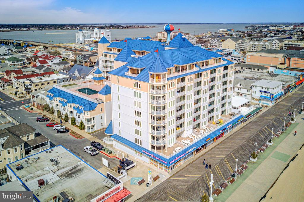 Direct oceanfront excellent rental investment or beach home at BelmontTowers located on the World Famous Boardwalk in Ocean City, Maryland. Fabulous views of the Ocean City Fishing Pier, Ocean City Inlet, Assateague Island, Atlantic Ocean, and Bay. Enjoy luxury living with an open floor plan, 9-foot ceilings, gas fireplace, granite countertops, designer kitchen, and a wet bar. Relax in the oceanfront master bedroom with a balcony. This fully furnished condo has an excellent rental income of $52,000 plus. Amenities include a rooftop pool, putting green, fitness center and sauna. ~2assigned parking spaces in a gate operated secure parking garage.