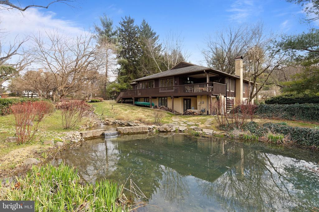 This California contemporary is situated at the end of a cul de sac on 1.2 private acres of bucolic landscaping, including a beautiful private pond and a stream with cascading waterfalls ~ a truly gorgeous setting!! This unique property was originally a barn, which was converted years ago, and you will find some of the original barnwood floors and post and beam construction that meshes beautifully with the contemporary design.  The house has been completely updated in the last 12 years, including new kitchen and baths, new roof , skylights and systems, some new flooring and windows, the addition of the pond as well as many new trees on the property.  This open floor plan home has many large windows that provide an abundance of natural light to the home. The main floor consists of a Great Room with fireplace and cathedral ceilings, large Dining Room with door to covered deck, and a custom Kitchen with Paradise custom cabinets, island, stainless appliances and granite tops.  The kitchen opens to a family room with slider to small deck.  The Master bedroom suite, with beautiful luxury bath and w/i closet is also located on the main level as well as an additional bedroom and full bath.  Downstairs you will find a large open family room with large windows.a wood stove and a door that opens to private patio plus two additional bedrooms and a nicely renovated full bath.  Don~t miss the wine cellar in the base of the original barn silo!  A definitely talking point!! There is also a cedar closet, a storage room and 2 car over-sized garage on this level. As you sit on the deck of this special home enjoying the beautiful views of the pond or the beautiful English walled garden, you won~t believe you are just minutes to trains, shopping and highways. This one of a kind property is within walking distance to New Eagle Elementary School, and is in top ranked Tredyffrin Easttown School District. Don~t miss this opportunity to make it your own.