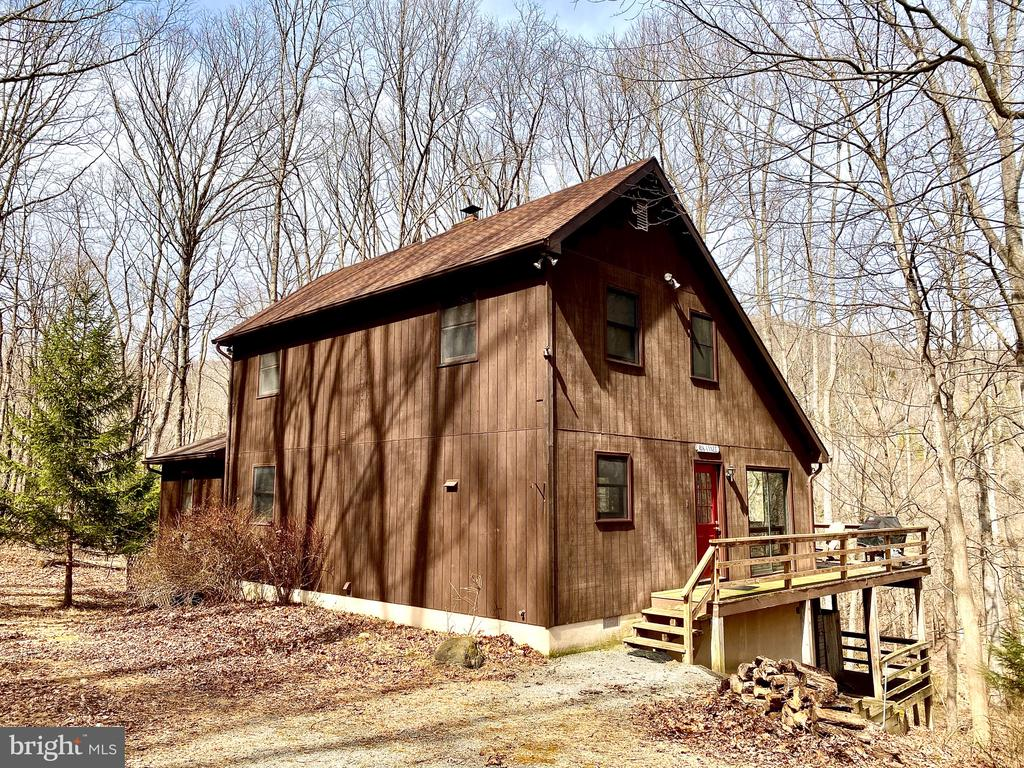 Much Sought After Water Front Home -  3.00 acres with 229' of water frontage along the Cacapon River plus 51+ acres of wildlife sanctuary across the river.   This home features:  3 Bedrooms, (M.BR has M.BA with shower and soaking tub) Den or 4th bedroom, total of 3 Bathrooms, Kitchen with range, refrigerator, dishwasher & microwave. Great Room with skylights, vaulted ceiling, tiled floor and wood stove.  Enjoying relaxing on the deck or screened in porch.  EBB heat and Central air.  This homes comes with most furnishings.    Get ready to enjoy the summer here!
