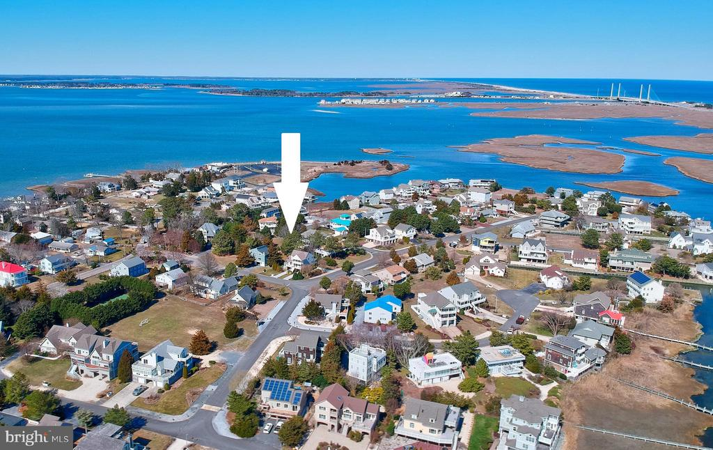 Build your dream beach home on this large parcel and enjoy the best of both worlds being tucked away in a quiet neighborhood, yet just minutes to the beach, boardwalk, restaurants, shopping and so much more! Located just 4 miles to the beach in a bayfront community with a private marina, kayak launch, tennis, and pick ball. Boaters can take advantage of renting a slip for only $500 a year and enjoy the convenience of having your boat docked just around the corner from your home.