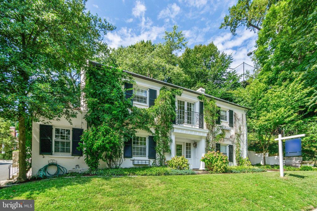 Charming corner home with a uniquely warm French Colonial style located in the heart of the treasured Massachusetts Avenue Heights neighborhood. The home consists of 4,909 total square feet on 3 floors from grade. First floor has entrance foyer, 2 bedrooms, 1 full bathroom, kitchenette, washer/dryer, and garage access. Second floor has living room, dining room, kitchen, 2 bedrooms (including master), and 2 full bathrooms. Third floor has 2 bedrooms, 1 full bathroom, and storage space. Total of 6 bedrooms and 4 full bathrooms. Many of the bedrooms are well positioned to be used as an office or sitting room as well. Original hardwood floors, crown molding, and 2 fireplaces; 1 gas. There is a full 2-car garage attached to the home. The home sits on a quarter acre lot (approx. 11,000 sf) providing a secluded rear yard backing on to woods. Plat available in Documents. This naturally well-lit home was updated in 2008 with new energy efficient windows and doors, new kitchen, and updated plumbing and electric wiring. A new roof was installed in 2017 with a 50-year warranty. The property over looks Rock Creek Park and is conveniently located walking distance to both Connecticut Avenue - Woodley Park and Massachusetts Avenue - Embassy Row / Naval Observatory. It is an approximate 8-minute drive to DuPont Circle, Georgetown, and Memorial Bridge. Within a half a mile one can easily access public transportation systems such as the Woodley Park-Zoo Adams Morgan Metro Station (Red Line), the DC Circulator, and Bus Lines N2, N6, L2, N4, and 96. Car sharing available from Zipcar, Car2Go, and Hertz On Demand. Woodley Park neighborhood has a Walk Score of 72. The assigned public schools are Oyster-Adams Bilingual School for elementary and middle and Wilson High School. Nearby private schools include Aidan Montessori School, Beauvoir, Maret School, Washington International School, St. Albans School, National Cathedral School, and the British International School to name a few. This is 