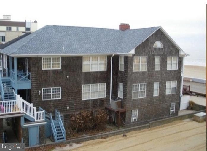 This is a rare opportunity to own your lot and building on Ocean's City's famous boardwalk. Large oceanfront lot on the boardwalk. 7,100 sq.ft lot. 6,000 Sq. Ft. of total interior space. This property boasts a rich rental history, with 5 separate apartments, all with the charm of Ocean City, including massive high ceilinged rooms, huge fireplaces, built-ins, fine woodwork, and well-built finishes. 5 units with a total of 15 bedrooms, 8 bathrooms & 5 kitchens. The apartments include 2 oceanfront 4 bedroom/2 bath massive units with oversized great rooms and dining rooms. 1 ground level 4 bedroom/2 bath walkout level with private patio, 1 2-bedroom/1bath lower level with bath 1 one-bedroom carriage house. 8 Parking spaces. Potential gross income of over $225,000 per year for $190,200 of NOI. 95% of the building was remodeled in 1986. Aside from the frame, nothing is more than 35 years old. More recently, over $150,000.00 in renovations have been done over the past seven years.Turnkey business ready to open the day after settlement. Most of the exterior and interior furniture can stay. The seller has a small list of pieces she will be keeping.Seller is willing to work part-time as a property manager for the new owner for free during the first year if needed.Seller also has a highly-skilled maintenance man willing to work at an extremely reduced rate the first year if needed.