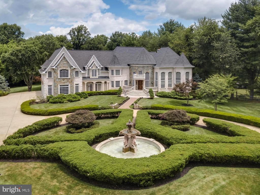 Reduced to sell in today's market, Motivated Sellers Moving! This timeless masterpiece was redesigned, expanded by 15,000 square feet, and constructed in 2006 with major updates in 2019.  Owner/Architect designed, magnificent 18,000 square feet, Chateau style custom estate, set on approximately 3 privately gated acres, lush professionally landscaped grounds, water features, 60 zone sprinkler system, outdoor lighting, resort living & grand entertaining. Embassy sized rooms, dramatic entry with custom hand-painted iron curved staircase, 9 bedrooms, 8 full baths, 5 half baths, 9 Custom fireplaces, elevator, chestnut wood study, Chef~s state-of-the-art kitchen. Light-filled lower level- Temperature controlled wine cellar, theater, gym, wet bar, LL ladies and gents restrooms, catering kitchen, Maid's quarters. Outdoor living- two outdoor kitchens, 2 outdoor fireplaces, outdoor saltwater pool & Jacuzzi, Tennis court, Cabana, Outdoor full bath. Generator. 4 car garage, Separate entrance to future loft apartment/multi-use space above the garage. All of this in the heart of Great Falls Virginia, a stroll to River-Bend Golf and country club, hiking trails, horse riding center, Potomac River Falls, Parkland, minutes to Dulles, Reagan National and Downtown D.C. Driving distance to the Plains, ski resorts, wineries, and horse country all in the foothills of the Blue Ridge Mountains.
