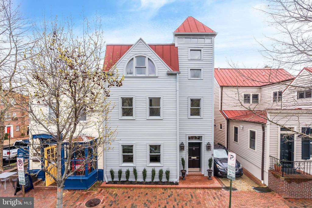 Originally built in 1925, this beautiful Georgetown residence is conveniently located on a charming historic street within walking distance to restaurants, shops, and the waterfront. The house boasts recent improvements including a new roof, new two-zone HVAC systems, new recessed lights, and new atrium skylights. It features generous entertaining spaces with large windows and newly refinished oak hardwood floors throughout. There is a spectacular three-story atrium entry foyer, which is complemented by a well-maintained exposed brick wall. The impressive main level includes a beautifully renovated gourmet kitchen with high-end stainless steel appliances, an adjacent formal dining room, powder room, and an elegant living room with a wood-burning fireplace, oversized windows, and French doors to the wonderful rear garden and terrace. The second level of the home features a luxurious master suite that overlooks the rear garden and features four closets and an en-suite bath. There is an additional bedroom with an en-suite bath on this level and a den overlooking the atrium. The third level of the residence features two additional bedrooms, a newly renovated hall bath, and an office with abundant sunlight overlooking the atrium. The lower level features ample cellar storage space and a utility room.  Completing this exceptional offering is a large private fully-fenced slate terrace with garden. Off site Garage Parking available for $125,000.