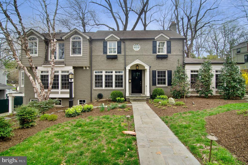 Meticulously renovated & expanded 4 BR 2.5 BA Colonial in popular Parkwood neighborhood. High end eat-in kitchen with custom cabinets, top-of-the-line appliances, breakfast island and adjacent family room with fireplace. Gleaming wood floors thru-out. Enviable screened-in porch w/2 decks, sun room with wet bar,  formal LR & DR. Master BR w/vaulted ceilings, two-sided fireplace & luxurious bath w/heated floors and heated towel rack.
