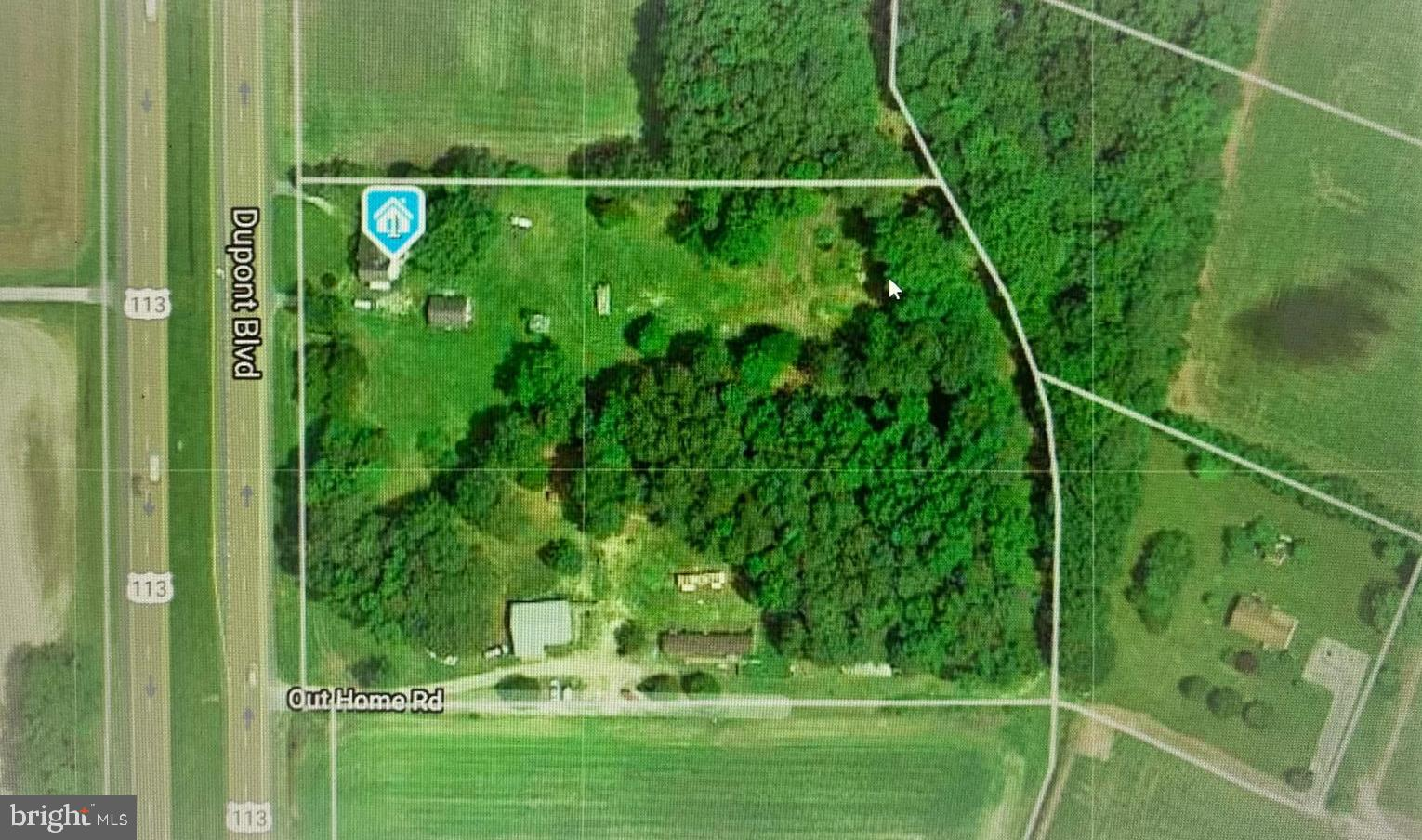 **Investors and visionaries alert!   This property is located on 5.32+/-  acres with 400+ feet of hwy frontage in Ellendale.  A large pole barn offers a full kitchen and bath. Additionally, it boasts an indoor swim spa all with handicap accessibility. The mature trees and secluded portion of the lot are perfect for multiple uses. This property is a diamond in the rough and can be subdivided. The original buildings on the property are in need of major repair and/or demo. This property is being sold as is and all inspections will be for information purposes only.   For your safety:  Enter the main home at your own risk and it is not advised to enter the trailer.