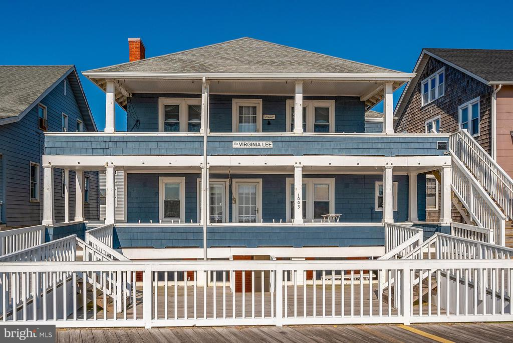 What an unbelievable opportunity to own a direct oceanfront Historic property directly on the Boardwalk in Downtown Ocean City! INVESTOR ALERT for this unheard of chance to own not just the home with 3 spacious units (1st Floor has a 2 bed/1 bath and 3 bed/2 bath, while 2nd floor has a 4 bed/2 bath,) a full and dry basement formerly used for apartments that is now storage and HUGE porches to take in the views, but also a separately deeded and BUILDABLE lot with 9 parking spaces as well! (TAX ID 10-035694)  Strong rental history here with the likelihood to do even better numbers! Ample Boardwalk frontage, outdoor hot and cold shower, located in the Opportunity Zone as well.  Now is the time to make an appointment to see!