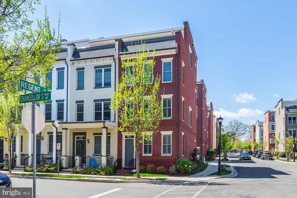 VIRTUAL OPEN HOUSE 5/16 from 12pm-2pm! Sign up on Eventbrite - link below. Come home to Chancellors Row! This stunning end unit townhome features four levels - 4 bedrooms and  3.5 baths.  The large open floor plan offers lots of space to entertain or have a cozy night at home in front of one of the fireplaces. Enjoy the multiple family spaces and the huge rooftop deck with amazing views of the  Basilica of National Shrine at Catholic University.  The many upgrades include green features, exposed brick walls, plantation shutters, crown molding, a wet bar with ice maker, a whole house vacuum system, an air purifying system, professionally organized closets, a finished garage with parking for 2 cars.  It's an easy walk to the metro station and everything that Brookland has to offer.  This home has it all!https://www.eventbrite.com/e/105533333040