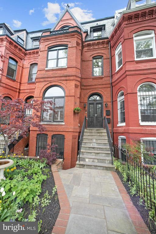 1890s Victorian row house converted into two condos.  Unit A offers 3 bedrooms, 2.5 baths, a private rear garden and includes a separately deeded garage parking space.  High ceilings with west & east facing windows provide great ambient light.  The kitchen is equipped with Wolf & Viking appliances and a wine fridge.  A large master bedroom with marble en suite.  An expansive main level that flows out to the garden.  Phenomenal location in Logan Circle.
