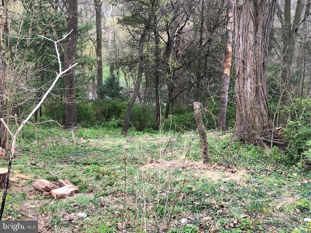 Great location just minutes to Lancaster in Lampeter Strasburg School District. Mostly wooded lot offers the perfect spot for a full daylight, walk-out basement. Any builder.   Plot plan included under documents. For GPS, lot located next to 130 Herr Ave, Lancaster PA 17602.
