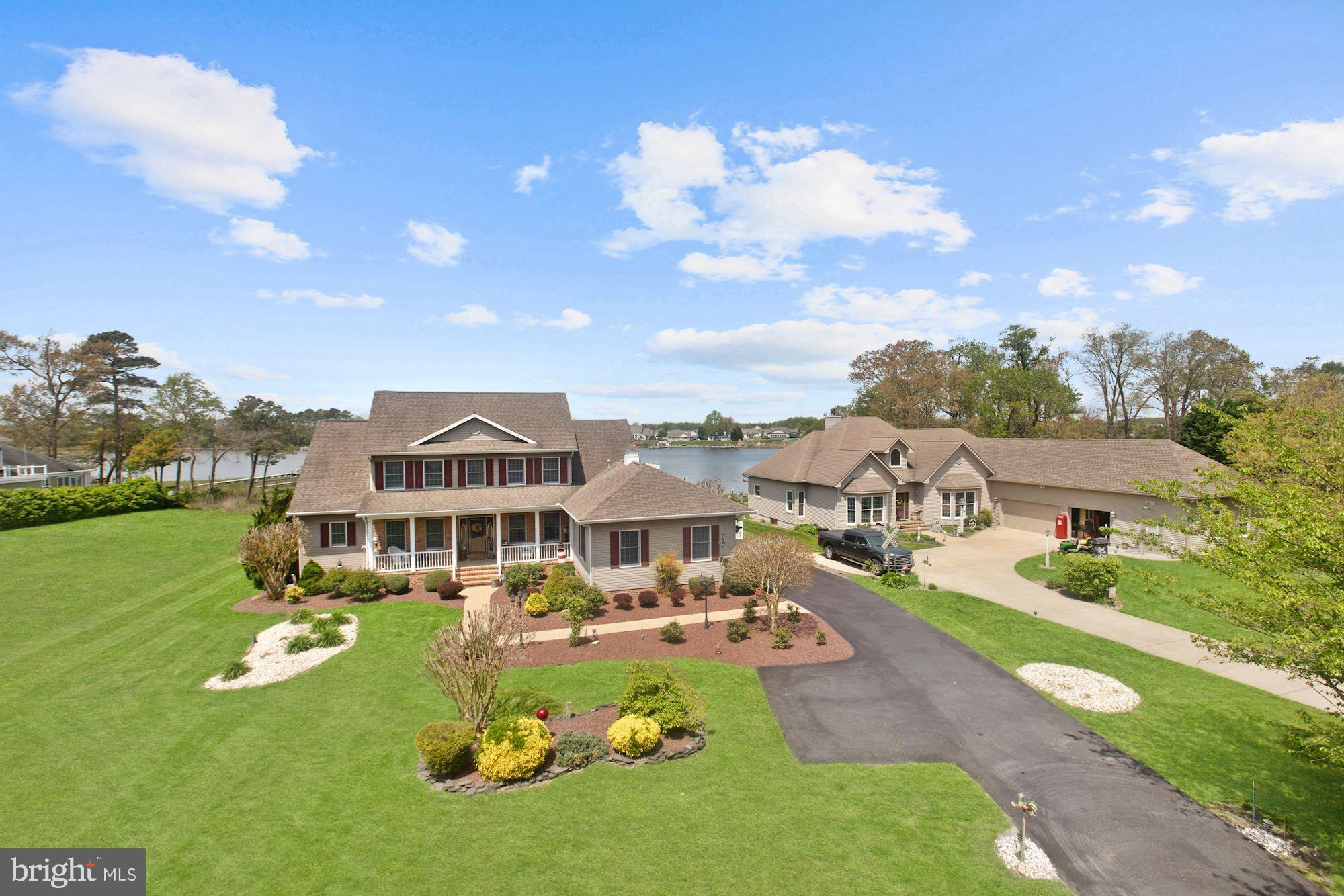 *VIEW THIS PROPERTY  VIRTUAL TOUR:  *http://spws.homevisit.com/mls/294074/122-RIVERVIEW-DR-DAGSBORO-DE-19939 **WATERFRONT with PRIVATE DOCK in the backyard!     This is the one you have been waiting for! Gorgeous custom built single family home in the much sought after community of the Point Farm. Custom features include a large main level master suite with a waterside sitting room, private bath, walk-in closet and private access to the deck for morning coffee and a view of the river. The main level open plan also includes a foyer sided by a separate dining room and study that unfold into a central waterside living space with a dramatic vaulted ceiling, gas fireplace, and dual sliders to an expansive composite deck overlooking a fully stocked koi pond.   Quality upgrades are a standard throughout this custom luxury residence, including Anderson sliders, windows, and remote awnings that wrap the living room, sun room and family room. Open to panoramic views, an entertainer's kitchen is fully equipped for any occasion with a center island, prep sink, breakfast bar, wine rack and cooler.  Plate your creations and dine inside, or gather with friends and family outside for a festive BBQ on the dining deck, stimulating patio conversations or refreshing water activities on the private pier and dock. Separately zoned, the second floor features include three bedrooms, one guest en-suite with a private attached bath and access to its own upper level deck and river sunsets. Two additional generously sized bedrooms and a shared bath provide plenty of room for visiting guests.Sited on a premium lot that is beautifully landscaped with immaculate low-maintenance materials, this pristine luxury property offers amenities for every one of every age. The Point Farm community located just west of Bethany Beach, offers tennis courts and low HOA fees. Life is short, move to the beach and enjoy inspired waterfront living!