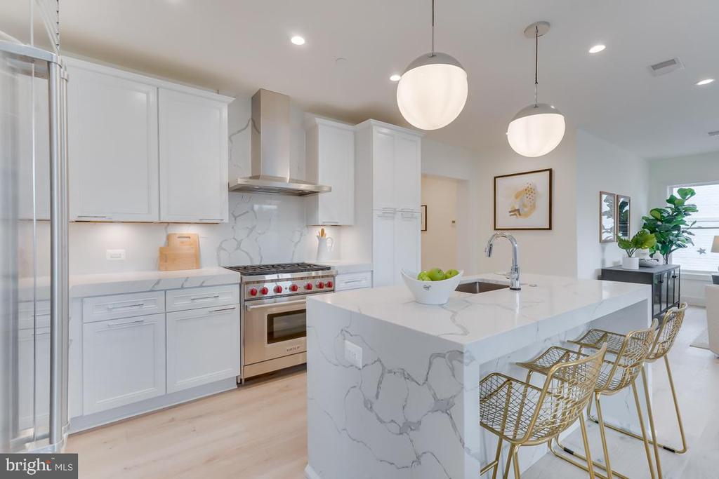 Nestled in the District's most coveted Logan Circle neighborhood, Boss Shepherd Condominiums offers 6 state of the art units with uniquely staggered interiors for optimum privacy. The penthouse offers a spacious and modern open floor plan with eight inch white oak flooring, recessed lighting and a ton of natural light entering from all four sides of the building. The gourmet kitchen is outfitted with a luxury high-end appliance package complete with a wolf range and sub-zero refrigerator.  The penthouse has two master suites, each with walk in closets, heated bathroom floors and are thoughtfully designed to maximize space and efficiency. Perfect for entertaining - you will have four outdoor spaces, including your own private roof deck.  Enjoy all the curated cafes, restaurants, shops, and nightlife right around the corner.  One parking space is included in the gated parking lot in the rear of the building. Square footage and taxes are estimated.