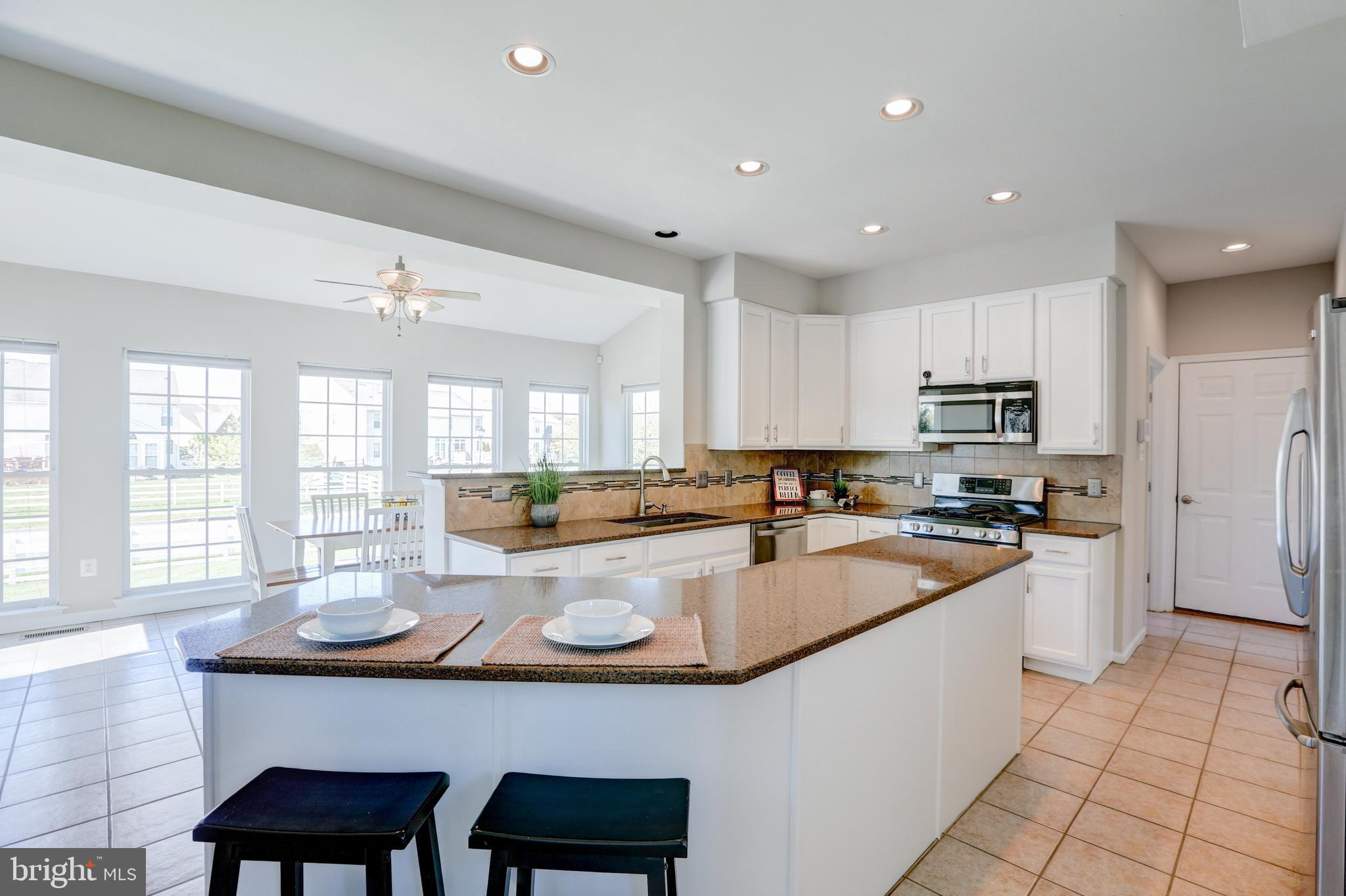 """One-of-a-kind is the best way to describe this new listing located in The Estates at Dove Run in the heart of Middletown. Not too often do we see a home so immaculate, so well cared for, so tastefully upgraded... and for that reason this home is truly in a class of its own! Starting from the outside, you'll appreciate its tidy landscape and attractive facade.  The atrium window over the front door is captivating with its size and ability to bring the natural light into the entrance of the home.  The rear of the home has a well designed trex deck allowing dual access both from the fenced portion of the yard, and the unfenced area.  Fully enclosed and LARGE, there is plenty of space back there to dream up a pool, shed, playground or more landscaping.  Enter the home and you'll be greeted with freshly painted walls-neutral in color, as well as a 2-story grand foyer.  Either side of you are the formal dining and living rooms, both well-lit with floor to ceiling windows and brand new flooring.    The rear kitchen is open-concept to a large family room and sunroom, and easy access to the rear deck/yard for entertaining!  The kitchen will entice you to cook more meals at home with its large counter spaces, gas cooking and double oven.  Also features white 42"""" cabinets, granite, and a tile backsplash!  Just down the hall is a full laundry room with washtub, and access to your spacious 2-car garage.  The upstairs features 4 bedrooms and 2 bathrooms, all new carpeting, and spacious storage closets.  The master suite has an enormous walk-in closet and garden bathroom~ (you may want to quarantine right in here).  But the absolute BEST part of this home is definitely the fully finished basement!  Custom laminate flooring, industrial rails and design features make it a unique experience that will quickly become your FAVORITE hang-out.   There is a bathroom down there as well as a movie theater, bar, exercise area, full exit door, and extra storage.   It could easily become an in-"""