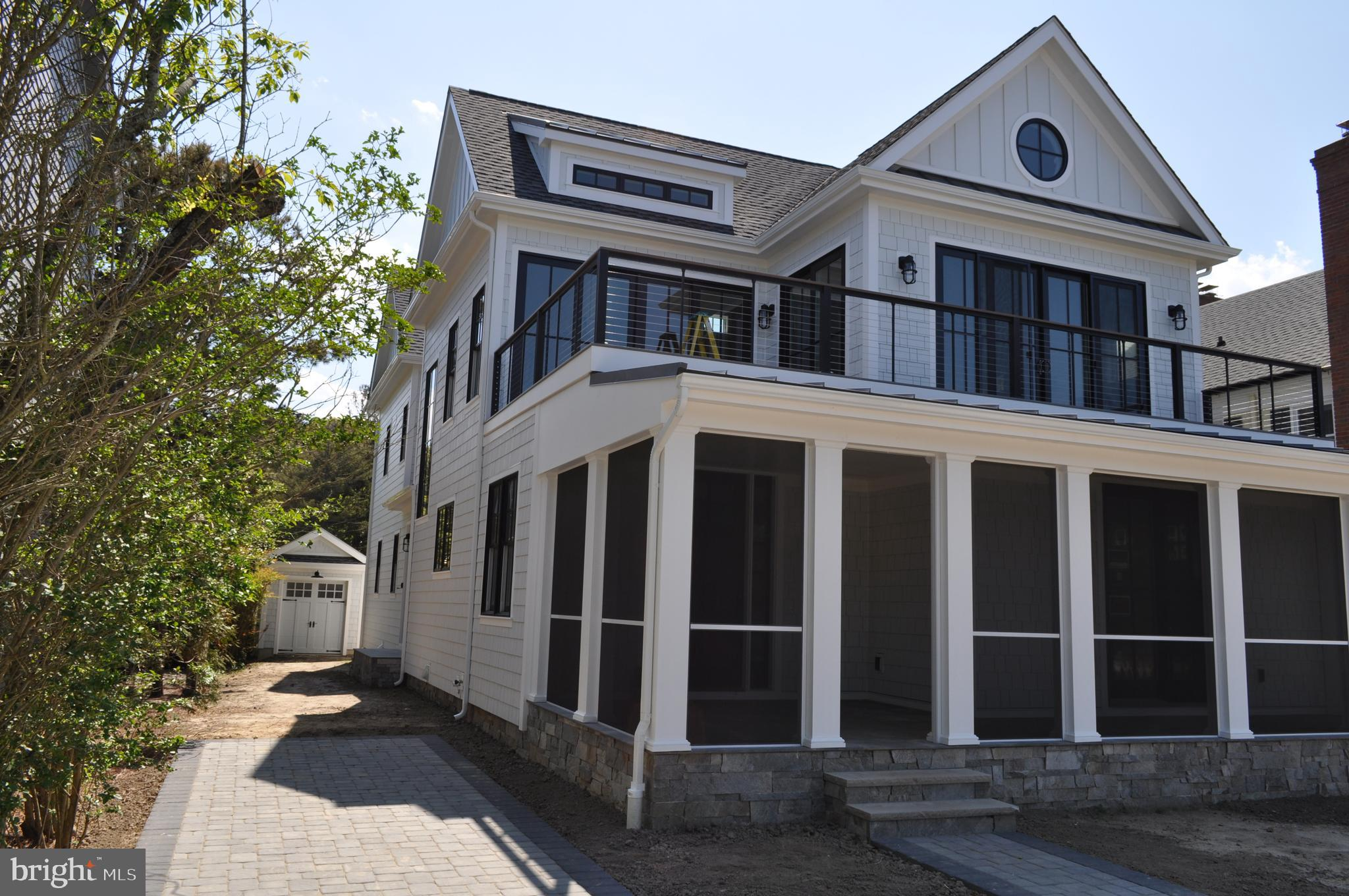 Oceanfront, brand new, top-of-the-line, 5 bedroom, 4 1/2 bath home located at 44 Surf Avenue in Rehoboth Beach.  Enjoy the ocean views, breezes, sound of waves and sunrises from this unique property that benefits from extremely wide dune protection and is not located in a flood zone.  Lot is 18 feet above sea level and no flood insurance is required. The inverted floor plan features a greatroom with beamed & shiplap vaulted ceiling, 2 owner's suites,  elevator, office, extensive wainscoting and shiplap millwork, fireplace, gourmet kitchen with huge island, custom cabinets, SubZero and Wolf appliances, Quartz countertops throughout, wide plank hardwood floors in all living areas and bedrooms, custom built-ins, screened porch, deck with cable railing, mudroom, basement with recreation room & lots of storage, detached bike/storage garage, exterior entrance to basement for beach toy storage, outside shower, 2x6 exterior walls, Andersen 400 series stormwatch impact windows & doors, and so much more. See attached list of features and construction specifications. Prime beachfront location and just a short walk to boardwalk, shops, restaurants, nightlife, and everything Rehoboth has to offer.  Ready for summer of 2020 enjoyment.