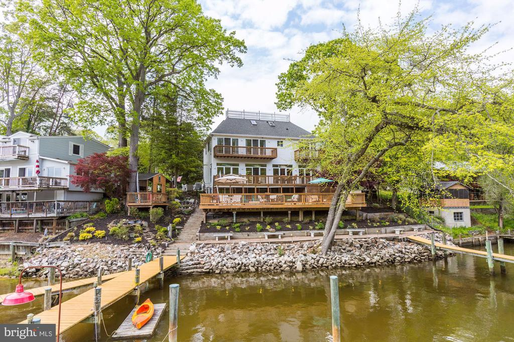 ***VIRTUAL OPEN HOUSE 5/23/20***Join us on Saturday, 5/23/20 at 1pm via Instagram Live (@brenthardie.sothebysrealty) or 130pm via Zoom (Meeting ID: 786 1212 7703 / Password: 425Shady) for the first virtual open houses of this property. This spectacular waterfront home is an entertainer and boaters dream. This amazing property boasts a large and open 4 bedroom/4 bath main home, a detached two car garage with apartment above (potential of $1k/month rental income), 150' of waterline, 2 piers that can accommodate up to 5 boats, a powered boat lift, and a massive brick patio/wood deck combo. Secluded from the world on the Blackhole Creek just off the Magothy River, you can live where other people dream of vacationing! What better way to escape the stresses of this pandemic by opening all the sliding glass doors to let the fresh air of the water in, listen to the geese and ducks splashing around, catch enough crabs to host a feast, and enjoy a happy hour at your own Tiki bar while taking in the beautiful sunset. Recent upgrades in 2019 include a completely remodeled kitchen, updated master bathroom, power washed and stained decking, and refinished piers.  Waterfront seclusion in Anne Arundel County doesn't exist anymore, don't miss out on this once in a lifetime opportunity!