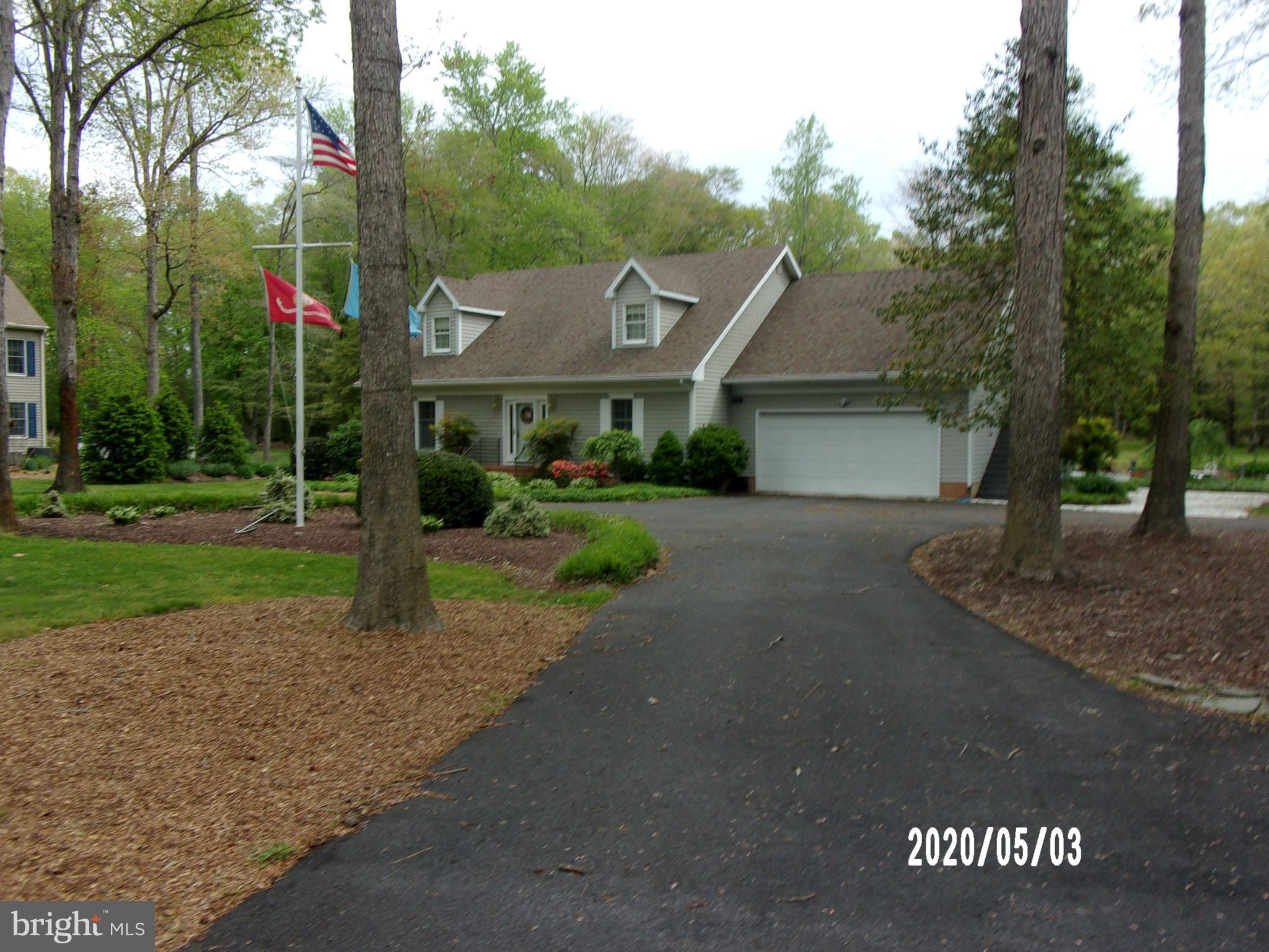 Attractive, clean Cape Cod style home.  Built in 1992 is located on 2 acres of a wooded lot.  The house has been well maintained and has one owner.  As you enter the property on an asphalt horseshoe driveway, your view is that of a peaceful, private setting.  The driveway has an extension on the right side of the property.  There are no HOA fees and minimum restrictions.  The area under the house was encapsulated in  2016.   The back yard view includes a nice size pond with rock garden and fountain.  There is a small dock and walkway around a portion of the pond.  The back yard also has a spacious dog run and double shed.   Two Adirondack  chairs located on the dock complete, peaceful, relaxing view of the back yard.There are two wells, one servicing an irrigation system which services the front and back yard around the pond.  The water is heated by propane (Rinna).  There is a water conditioning system.The home has a screened in porch off from the master suite and a deck which extends the entire length of the back of the house.   The deck connects to a walkway and dock overlooking the pond.Inside as you enter the house you~ll find a vaulted foyer with a view of the stairway leading up to the second story.  There are hardwood floors in the foyer, dining area, great room and kitchen.  The bedrooms are carpeted.  The great room includes a well-appointed ample kitchen with stainless steel appliances (5 burner stove, regular oven,small warming oven, stacked drawer dishwasher and granite counter tops.  There is a see through gas fireplace surrounded by built in floor to ceiling shelves.  Lighting is recessed in the great room, kitchen and master suite.  There are 3 bedrooms and 2 &1/2 baths.The master bedroom (suite) is located downstairs off from the kitchen, there is a laundry room with 2 door closet and sink.    The master bath includes a sauna/shower and whirlpool bath, double sinks and closet.  The master suite also includes a walk in closet and see through fireplace.The home is heated and cooled by 2 zone heat pump system which has been updated (one for upstairs and one for downstairs).Additionally, there is a fully appointed apartment located over the garage.  It includes additional a full bath, apartment size range/oven, under counter refrigerator, two single mattresses which serve as window seats under 5 Anderson over/under paned windows, 2 spacious closets, fireplace log attached space heater and separate entrance.  As is true of most Cape Cod homes, there is a large attic area as well.This home is perfect for scenic, spacious indoor and outdoor entertaining!    Make it yours.