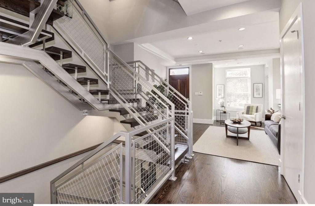 Luxury in the city. Take a look at this custom designed rowhome in the middle of Ledroit Park/Bloomingdale neighborhood. Features abundant natural light, contemporary design and a full bed/bath parity. This energy efficient smart home allows you to control your lights, TVs, temperature, music (through built in speakers in the walls), security cameras and more all from an app on your phone anywhere in the world. The home features 4 bedrooms 4.5 baths and over 3000 sqft of finished space. A formal living room, family living room, grand kitchen and a media room with sonos surround sound system. Secured parking for two vehicles. Only a 7 minute walk to Shaw metro station.