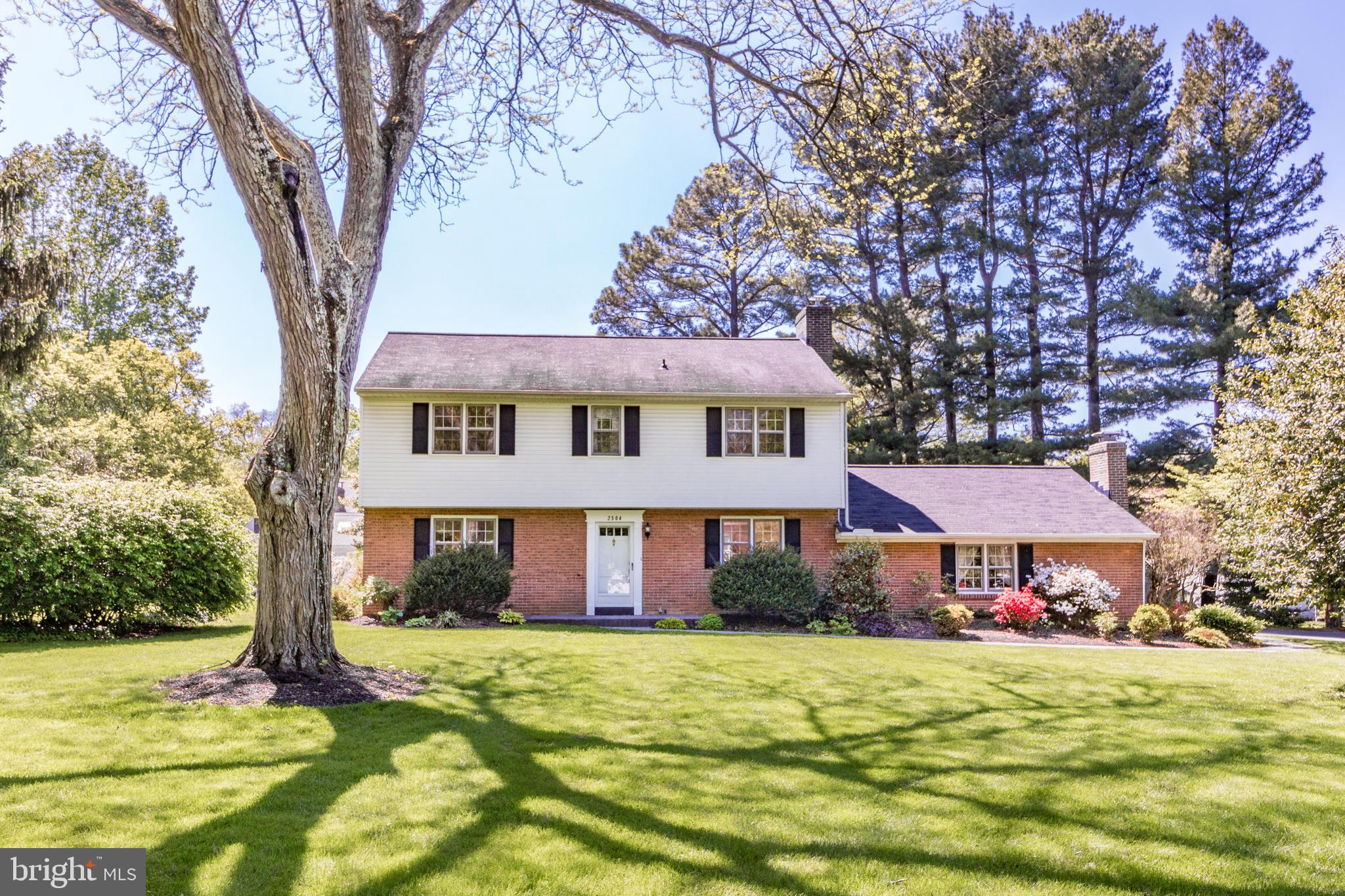 Don't miss out on this beautifully maintained 4 bd, 2 1/2 bath Center Hall Colonial in the desirable tree-lined neighborhood of Foulk Woods! The curb appeal is undeniable with gorgeous mature landscaping, private backyard oasis and side entry two car garage on a spacious .65 acre corner lot! Enter into the warm and inviting foyer with fresh, neutral paint and hardwood flooring that runs throughout both levels. To your right is a formal living room with a gas fireplace and to the left is a light-filled dining room with chair rail and crown molding. The dining room leads into the updated eat-in kitchen with maple cabinets, stand up bar with custom barstools, update tile backsplash and granite countertops with all of the bells and whistles of a custom designed Giorgi Kitchen. Adjacent to the kitchen is a remodeled powder room. Off the living room is a large sunken family room with the second gas fireplace flanked by built-ins. This cozy room has overheight exposed wood beams, brand new carpet with tiled area as you come in from the garage.The rear of the house offers a bright updated sunroom with wainscoting, plank flooring and large sliding windows for all season enjoyment.  The sunroom leads to a stamped concrete patio with wall seating surrounding the built-in copper fire pit. On the second floor the master suite offers two large closets and an updated full bath. There are three additional bright and airy bedrooms which share a remodeled hall bath. The unfinished basement is currently used for storage but could easily be converted to usable living space. Recent updates include epoxy garage floor, expanded and repaved driveway, stamped concrete patio, walkway and walls, attic insulation, HVAC system, water heater, new paint throughout. Conveniently located to Route 202, I-95, area shopping, restaurants and more! Schedule your tour today! For Virtual Tour go to https://www.youtube.com/watch?v=qKudHRC-XJs