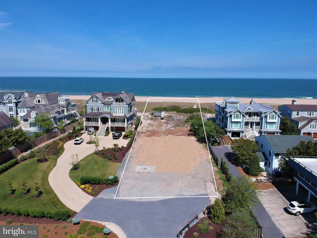 With 75 feet of pristine Oceanfront, this parcel of land provides a rare opportunity to build a new dream beach home within the highly desirable community of Dukes Dune. This .40 acre over-sized lot is situated among 4 newly constructed luxury homes in one of the most sought-after locations on the Delaware Coast.  This property offers the unique ability to construct a sizable home with the option for a private pool while capturing unobstructed ocean views as well as evening sunset vistas over the Salt Pond.  Enjoy direct beach access from your personal boardwalk to a quiet, secluded beach while maintaining the convenience of being just a short walk into town.