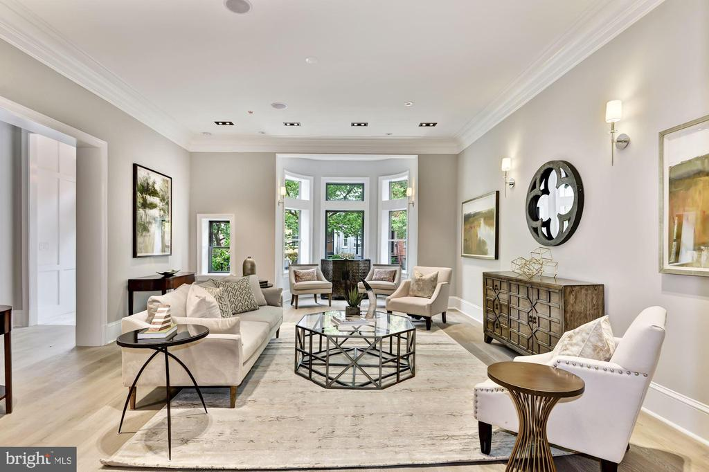 One-of-a-kind and fantastically chic describe the largest condo in Logan Circle.  Residence Two at The Logan boasts a private entrance from Q St., and has an enviable terrace and two-car, secured parking with a charging station. It lives like an undated, modern Victorian while providing the turnkey life of a condominium for graceful getaways.  This three bedroom and three-and-a-half bath residence is the epitome of grandeur, where century~s old craftsmanship and style were meticulously blended with modern convenience and carefully curated interiors to present the opportunity of a lifetime. Open living with expansive proportions, flowing entertainment spaces, and a state-of-the-art Snaidero kitchen are among the many highlights of the home. Spanning approx. 3460 sq. ft, the residence includes a living room, formal dining room, family room and a library. Enjoy urban living when you want as it is located in the heart of Logan Circle and is walkable to LeDiplomat, Whole Foods, and countless other destinations, but thrive in your own private sanctuary when you so desire.