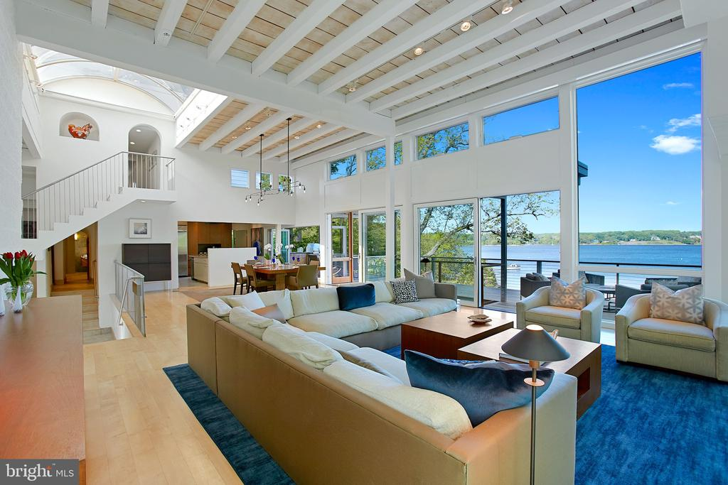 """This stunning contemporary waterfront home has expansive and breathtaking views of Weems Creek and the Severn River from the main living areas, bedrooms and large pool and entertainment room.  Huge glass doors fold away to create an indoor-outdoor space that feels like it is floating high above the waters edge.  Open-design floor plan is filled with light from all sides and is perfect for entertaining yet completely private.  Dramatic two-story library/office provides an oasis to work from home and then quickly get out on the water when your day is done. Very seldom will you find waterfront with two deep water slips and views like these close to downtown Annapolis and convenient to DC, Baltimore and BWI. A complete video tour  is available by clicking onto the Virtual Tour Link or you can also submit the address within YouTube to view the entire HD quality video. Details for an """"appointment required"""" Open House will soon be released."""