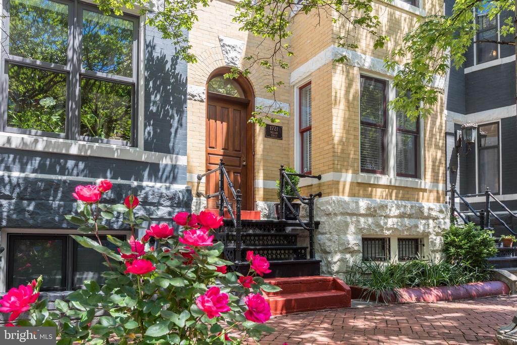 Let the story be told, about a quiet, tree lined street in Dupont Circle and the dream home you've waited for. Built in 1905, this exquisitely renovated Victorian offers three levels plus a finished English basement, all just steps from restaurants, shops and coffeehouses. There is 3,204 square feet of living space with heart of pine floors, four fireplaces plus a family room/library. Windows wrap around a mesmerizing kitchen with granite counters, recessed stainless steel appliances,  cooking island and a secondary sink. Four bedrooms, 3.5 baths plus bonus space. How about a top floor master bedroom suite with tiled fireplace, private dressing room and an incredible redone marble bath? Extras include an office, sun-splashed roof deck, exercise room, sky lit stairs and private on-site parking. Bring your journey home! See complete media suite for this beautiful home at www.LiveInDupont.com/1721Willard