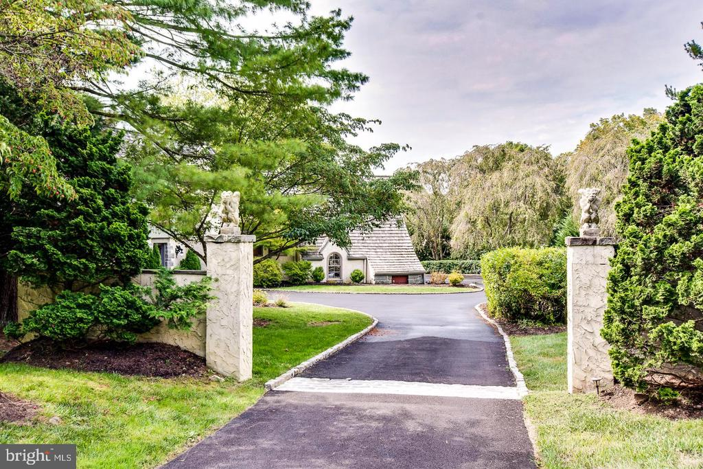 This French Normandy style masterpiece was created by renowned architect Fred Bissinger in 1980. It was lovingly renovated in 2011 and again in 2019. This Mount Pleasant gem is hidden from the road at the end of a new, private driveway, waiting to enchant visitors with a charming combination of grandeur and warmth. Nestled on 1.16 acres of lush, landscaped lawns and well-groomed forest, this home has vaulted ceilings and architectural windows throughout, offering a bright, open layout and stunning views from every room. Favorites include the Great Room ~ an octagonal-shaped, gazebo-inspired family room with 15~ domed ceiling; the Master Suite with abundant closet space, soaking tub and walk-in shower with a trio of indulgent wall jets; private and newly renovated lower level Guest Suite with separate entrance; newly renovated Fitness Studio; Executive Office with abundant light; an 18~ Entertainment Bar; five gas fireplaces; rich architectural details throughout, including in the foyer and kitchen floors and Great Room fireplace inserts of the famous Mercer Tiles; privacy from neighbors and all of the modern amenities one would expect from a recently renovated Main Line treasure