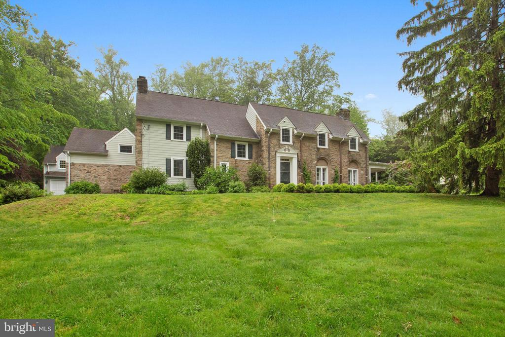 Seller will accept site unseen offers! 360 Virtual tour: https://virtual.homejab.com/HOJ/795HarrisonRdVillanovaPA/index.htmlYou will not want to miss this beautiful, private, six-bedroom home in Villanova! They don~t build them like this anymore. Built in 1932, this spacious home is located in a desirable neighborhood with many magnificent homes! It is surrounded by five terraces/patios, three brick and two flag stone. Move past the lush yard and front brick terrace into the entry foyer with beautiful hardwood floors and freshly painted walls. Straight ahead is the den and to the right is the large living room, both with wood-burning fireplaces. To the left of the foyer is the dining room, also with a fireplace, perfect for hosting lavish dinner parties. Flow into the eat-in kitchen with recessed lighting, tons of cabinetry, and a large center island. An additional dining area is perfect for enjoying a family breakfast before the day starts. Off of the kitchen is the spacious family room with an abundance of windows to let in the light, and radiant heat in the floor. On this level are two half baths for added convenience. Move upstairs to find five spacious bedrooms, three full baths, and one-half bath. A laundry closet is also located on the upper level for your convenience. The third floor features a large, walk-up attic, great for winter/summer storage. The detached, two car garage includes a spacious third bay behind for storing sports equipment, bikes, and gardening tools, with an outdoor shower just because! Above the garage is the sixth bedroom or studio with full bath that could easily be used as an in-law suite or office. The backyard offers complete privacy, many mature plants and trees, and an incredible in-ground Viking pool and above-ground hot tub! With a bountiful amount of private, outdoor space, this home is everything you could want on the Mainline. Conveniently located near the Village of Ithan and downtown Wayne, in minutes you can be shopping or