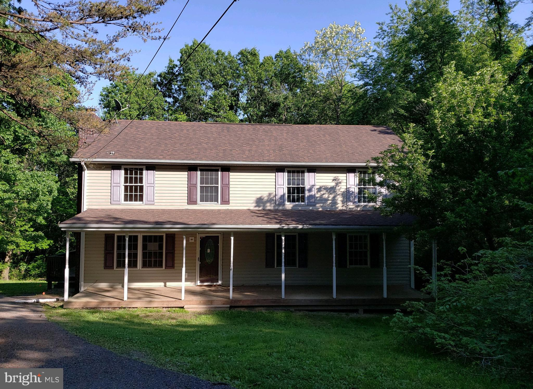 Colonial style home sits on approx. 1.5ac wooded lot in Apple Orchard Acres. Home features 4 BRs, 3 FBs, covered front porch and partially finished basement with fireplace.