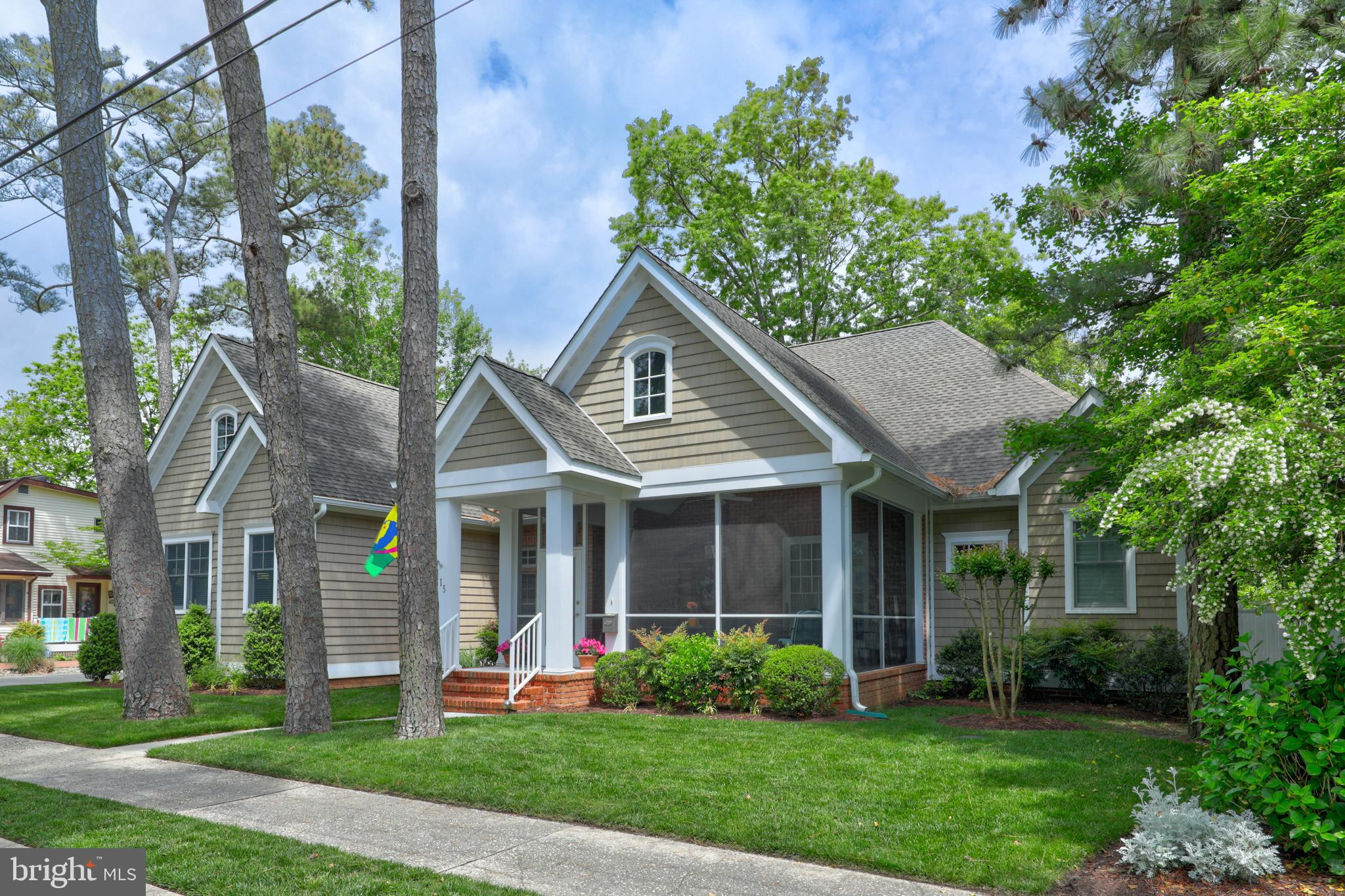 Oversized opportunity on a double lot in South Rehoboth just a block and a half from the ocean.  Built in 2011 before the tightening of restrictions, this 4,892 heated square foot home (6,179 square feet under roof including garage and porches) is approximately 30 percent larger than currently allowed.  Enter to a gracious living and dining room in this sprawling 5 bedroom home featuring 3 ensuite bedrooms downstairs, family room, office, spacious front porch, rear porch, side deck plus 2 bedrooms upstairs, a huge bunkroom with unfinished bathroom. There is a two-car garage, irrigation system and an outdoor shower.  Discerning buyers will appreciate many wonderful features including a coffered ceiling, vaulted ceilings, two fireplaces, hardwood floors, extensive custom cabinetry, granite counters, handsome moldings, a well-appointed kitchen, a luxurious master suite with two full baths and the quintessential front porch.  Perfect opportunity for large groups and multi-generational families.  Rare 100x100 lot!