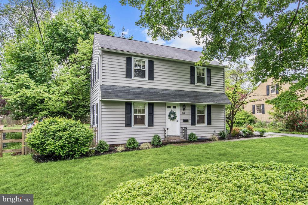 Recently updated Center Hall Colonial in Great Valley School District, within walking distance of downtown Malvern and the Paoli Train Station (Septa and Amtrak).Located in a walkable neighborhood with mature trees, this home boasts the craftsmanship of mid century building along with upgrades needed for modern living, as it was recently renovated in 2015. As you approach the first thing you will notice is the Carolina Bead Board siding and beautiful landscaping in the front and side yard. Step in the front door and to your left is an oversized living room perfect for entertaining, complete with original oak hardwood flooring, crown molding that carries throughout the remainder of the first floor, and custom roman shades that carry throughout the entire house. To your right is the formal dining room with wainscoting, that also works well as a playroom if formal dining isn't your style. In addition, the dining room has access to the side entry door as well as the cute cubby area perfect for organizing your coats and shoes. Off of the cubby area is an updated half bath complete with small format white tile with dark grout. At the back of the first floor is the open kitchen and breakfast nook with three walls of windows/ doors to allow for lots of natural light. The kitchen is complete with white shaker style cabinets and granite counter tops from Century Kitchen along with stainless steel appliances, and new engineered wood flooring. Walk out the kitchen through the backdoor and you will find a backyard oasis like no other complete with beautiful landscaping, a fenced in yard, and a huge paver patio perfect for grilling, a fire pit, and an outdoor living room. The patio also provides access to the detached 1.5 car garage that is the perfect size for parking a car and storing all of your tools and lawn equipment. Back inside, across from the kitchen is a small pantry and stairs to the unfinished basement. Even though it's unfinished, the basement provides a great amenity with room for the washer and dryer, a large bar, and even a full workout area. Back on the main floor, stair by the front leads up to the second floor complete with the same original oak flooring throughout the hallway and all four bedrooms, and an updated full bath with white tile throughout and a new vanity. The master bedroom has ample storage and is large enough for a California King bed. Two other rooms are the perfect size for kids rooms/ a nursery and include plenty of closet space. The last, and second largest bedroom is perfect as a guest bedroom/ office. This home really packs a punch with all the space where it counts, a full four bedrooms, and all the best suburban living has to offer while being only a 25 minute train ride from Center City. Schedule your tour today, as it will not be on the market long!